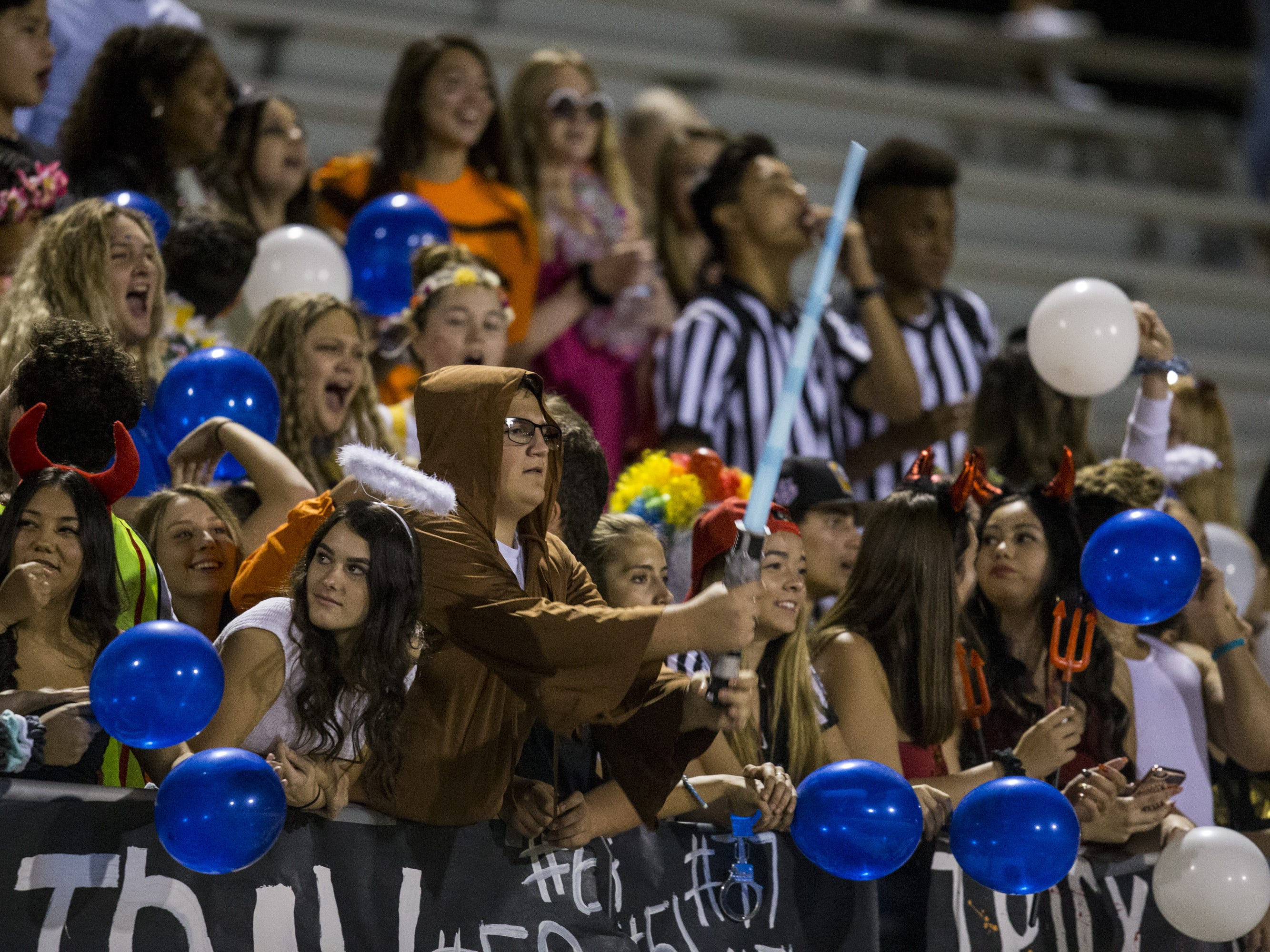 Mesquite fans in costumes watch before the game against Saguaro on Friday, Oct. 26, 2018, at Mesquite High School in Gilbert, Ariz.  #azhsb