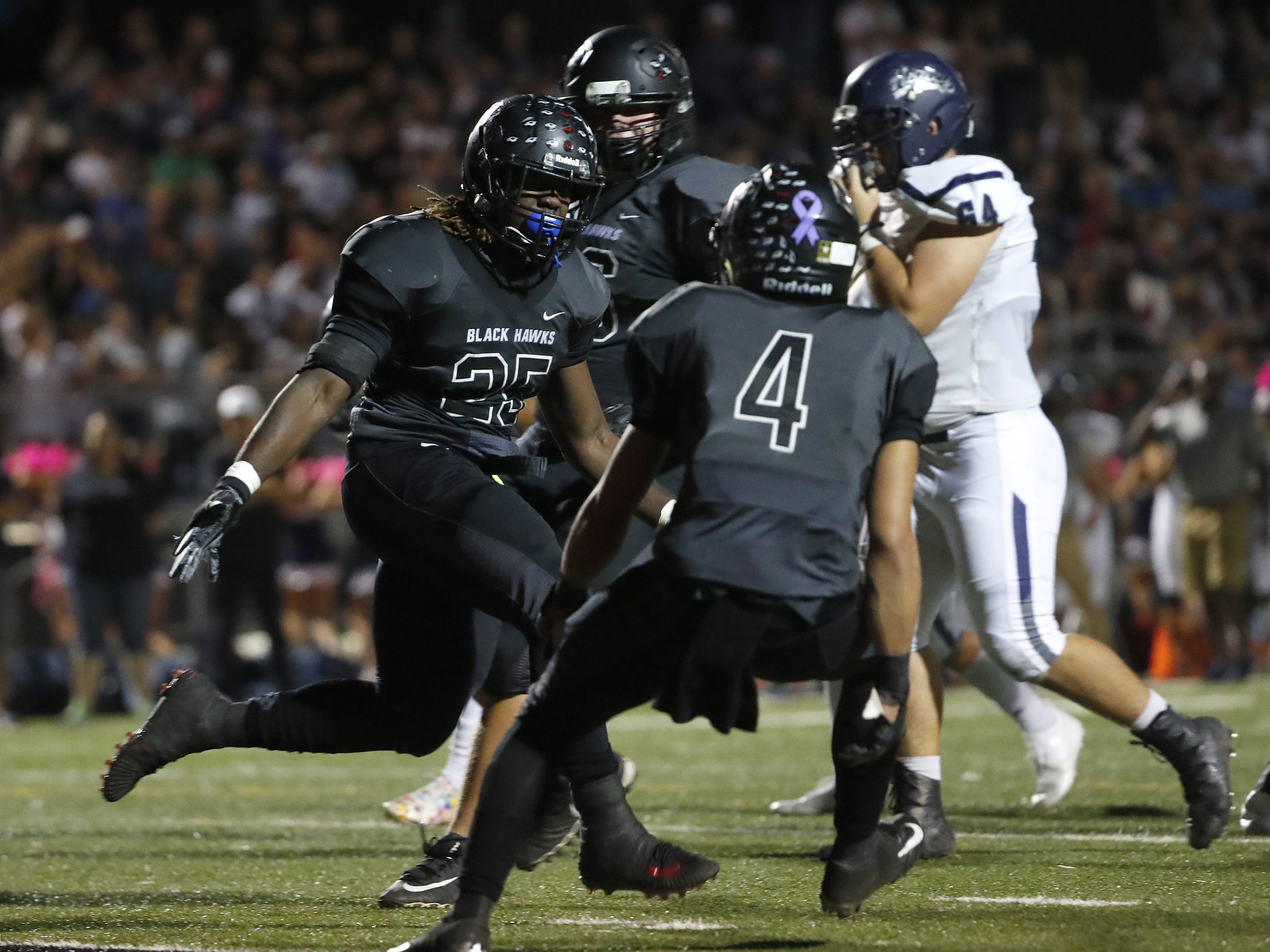Williams Field's Jaden Thompson (25) celebrates with 	Elijah Reed (4) after scoring a touchdown against Higley during the first half at Williams Field High School in Gilbert, Ariz. on October 26, 2018.