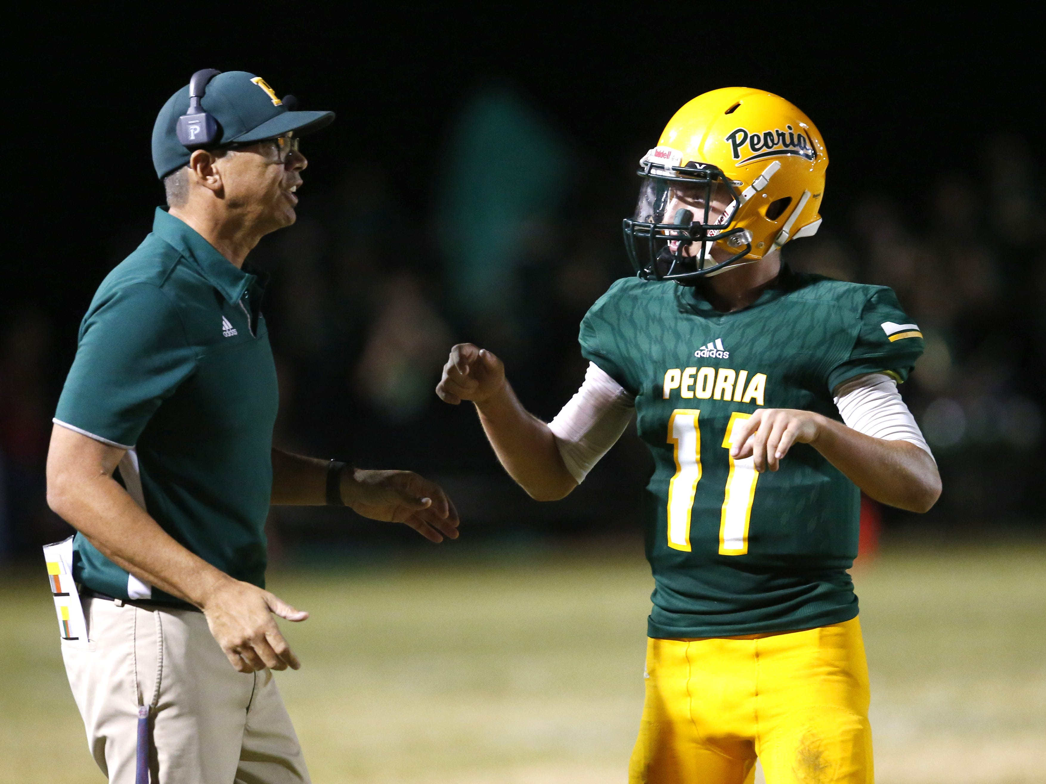 Peoria head coach Will Babb talks with quarterback Kyle Samford (11) during a football game against Cactus at Peoria High on October 26. #azhsfb