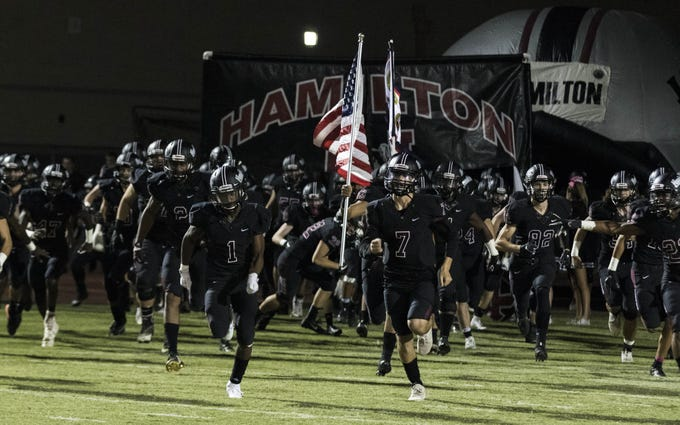 Hamilton Huskies run out onto the field before their game with crosstown rivals the Chandler High Wolves in Chandler, Friday, Oct. 26, 2018. #azhsfb