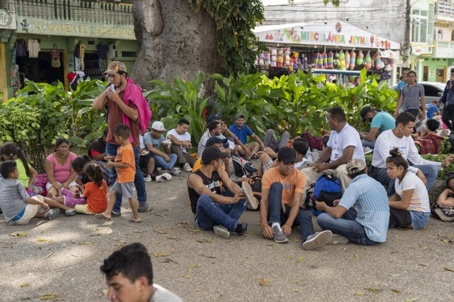 10/26/18 1:12:41 PM -- Guatemala. A new wave of several hundred migrants from Honduras and El Salvador gathered near a park in Tecun Uman Guatemala. They waited to cross the Suchiate River that divides the two countries between Guatemala and Mexico in hopes of heading north to the United States. Under pressure from the United States, Mexico shut the bridge in an effort to halt another wave of migrants, mostly Hondurans, from crossing the border into Mexico. Photo by Nick Oza, Gannett.