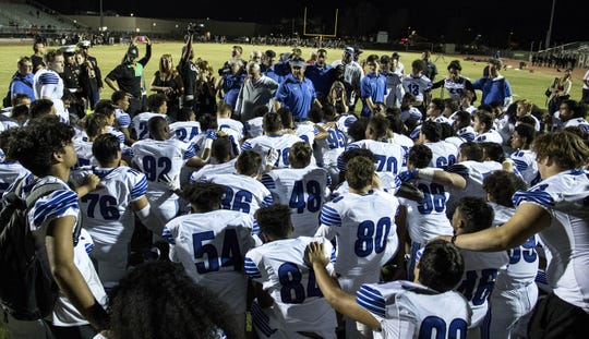Chandler head coach Shaun Aguano talks to his team after their 49-7 win over crosstown rival Hamilton, Friday, Oct. 26, 2018. #azhsfb