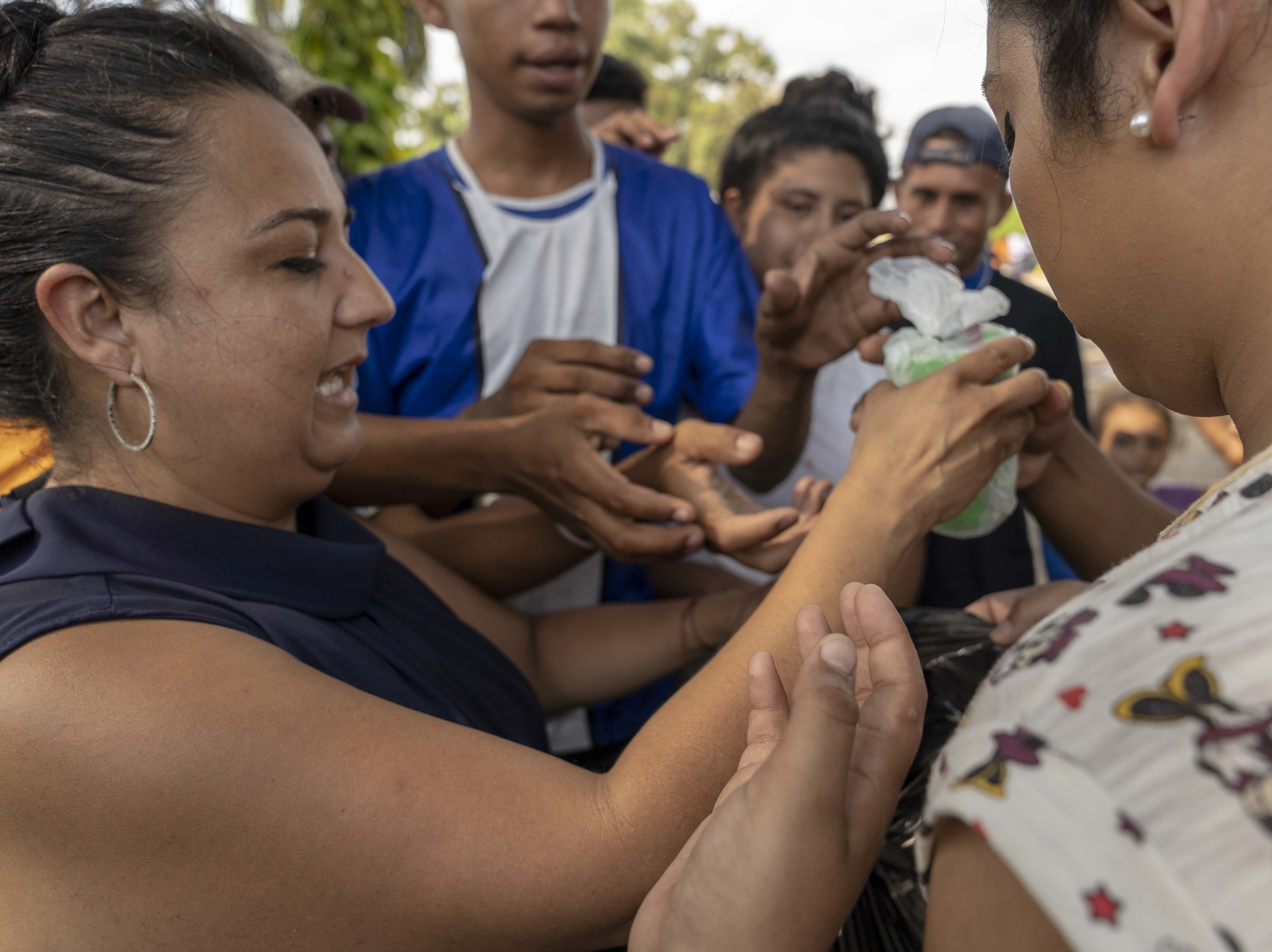 Central American migrants desperate for food receive donations from local charities in Tecun Uman, Guatemala.