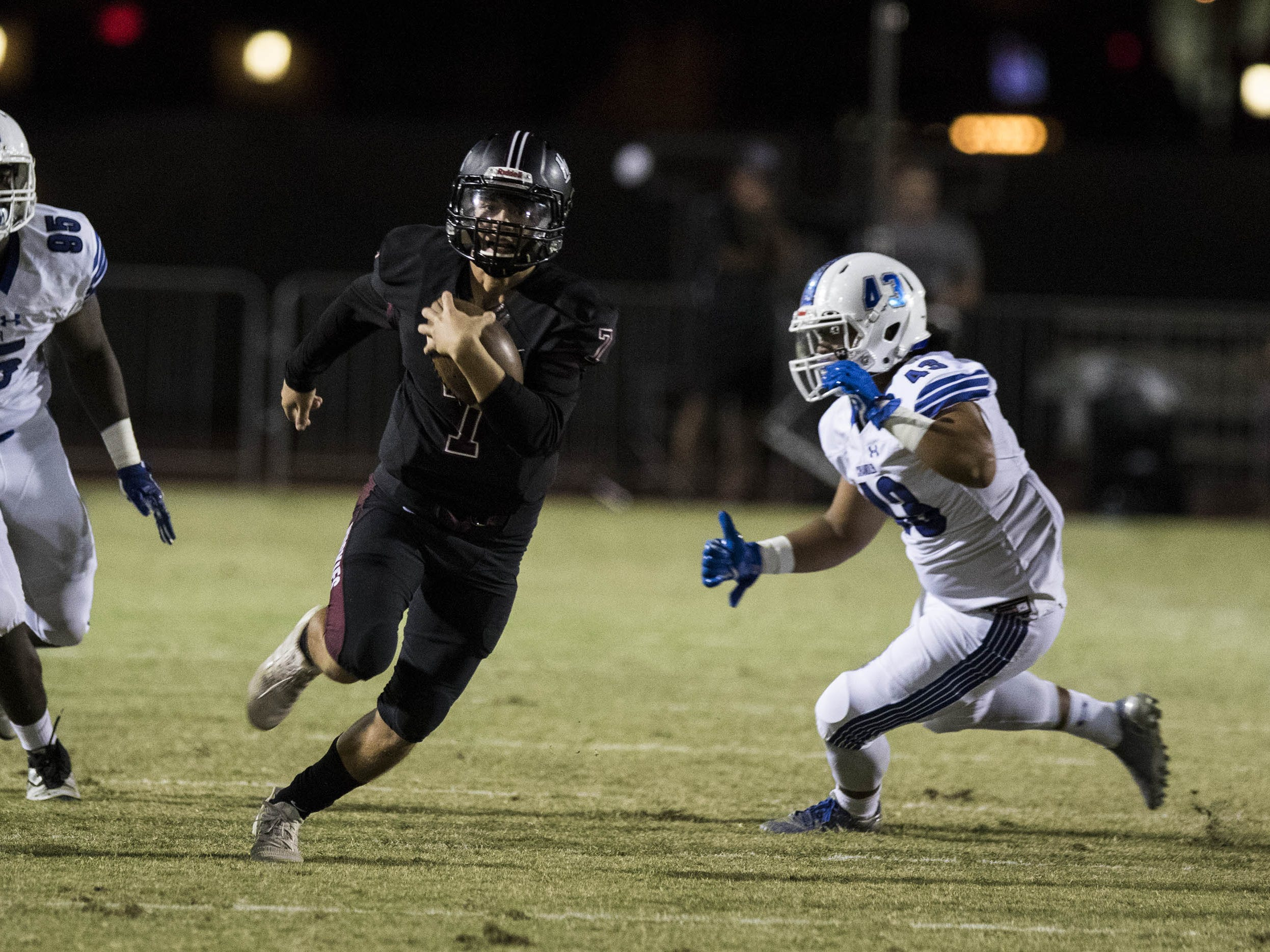 Hamilton's Nick Arvay finds running room against the Chandler defense during their game in Chandler, Friday, Oct. 26, 2018. #azhsfb