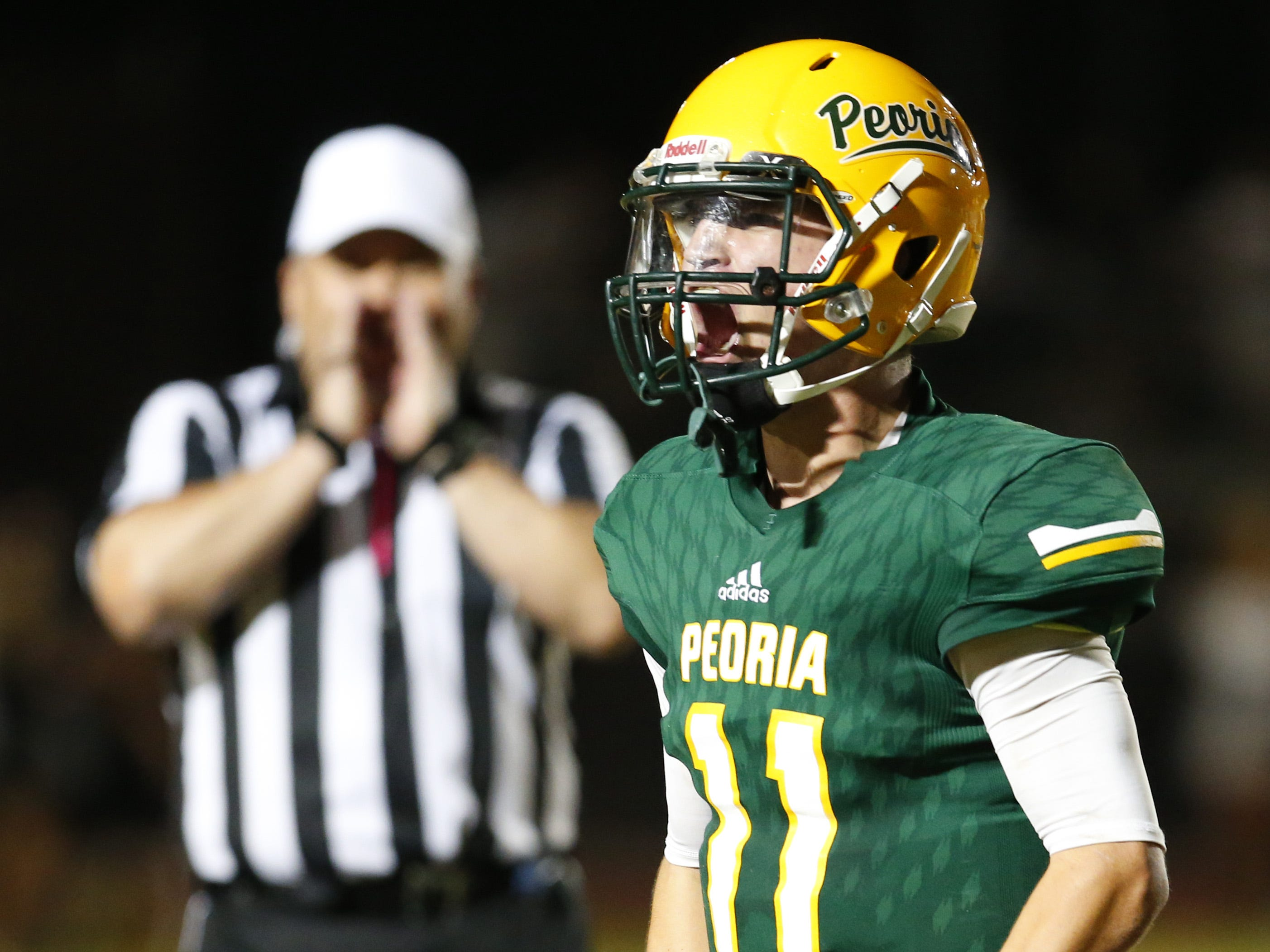 Peoria Kyle Samford (11) celebrates defeating Cactus during a football game at Peoria High on October 26. #azhsfb