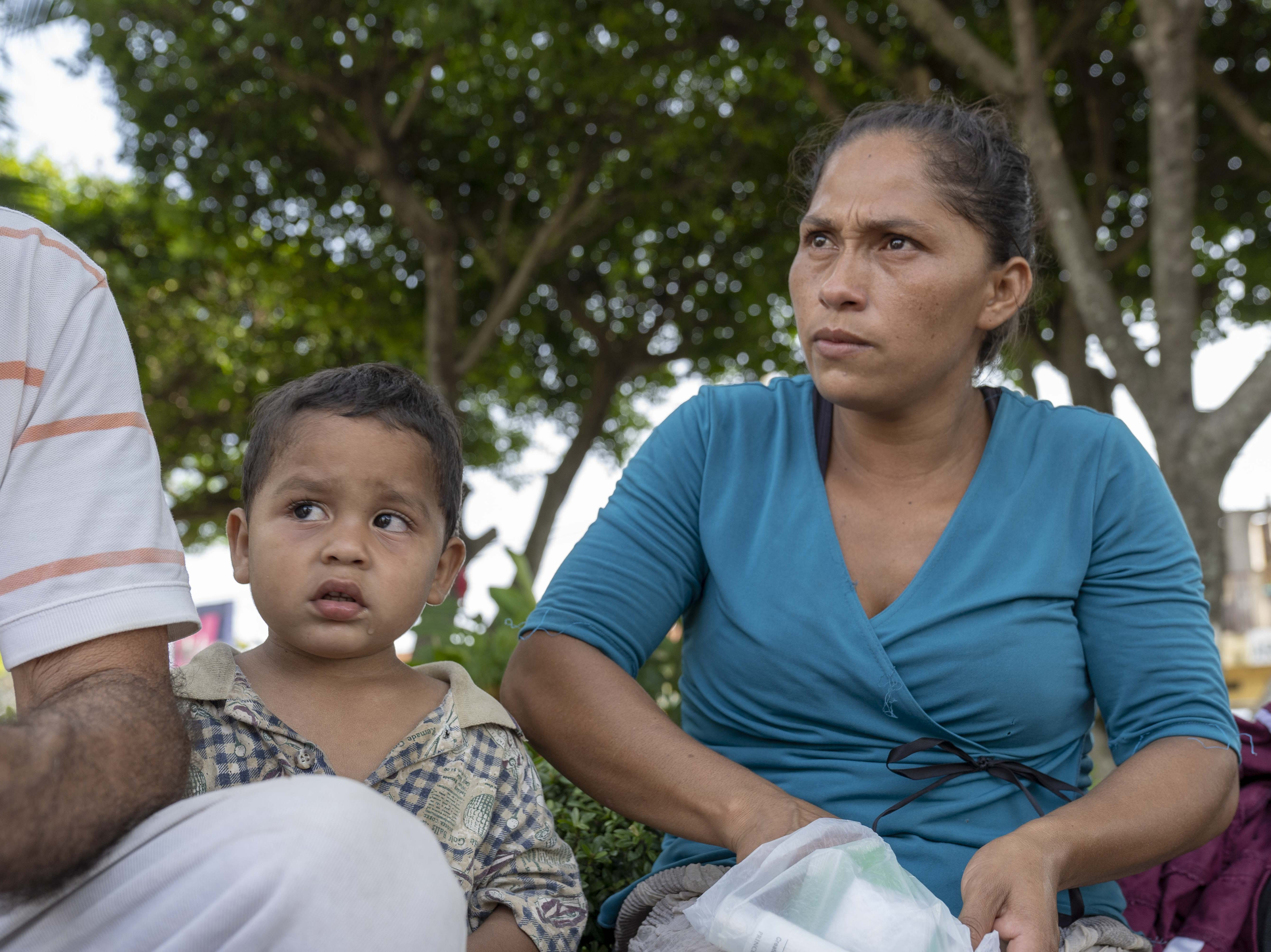 Migrants from Honduras and El Salvador gather near a park in Tecun Uman, Guatemala.