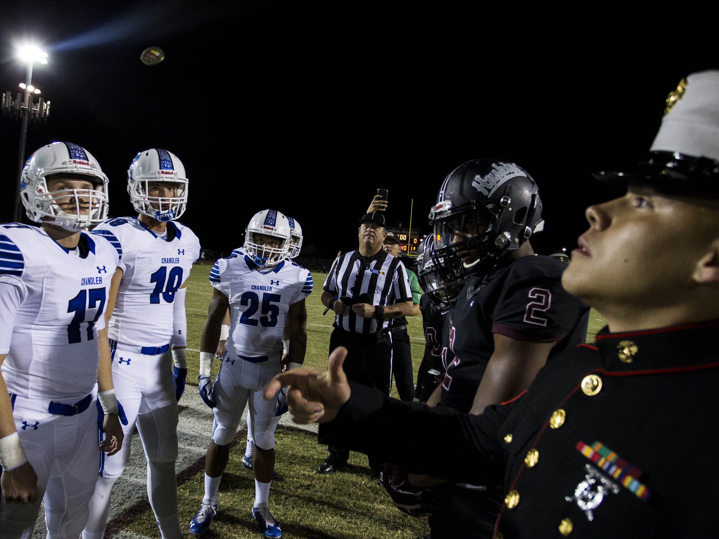 Chandler and Hamilton captains watch the coin toss before their game in Chandler, Friday, Oct. 26, 2018. #azhsfb