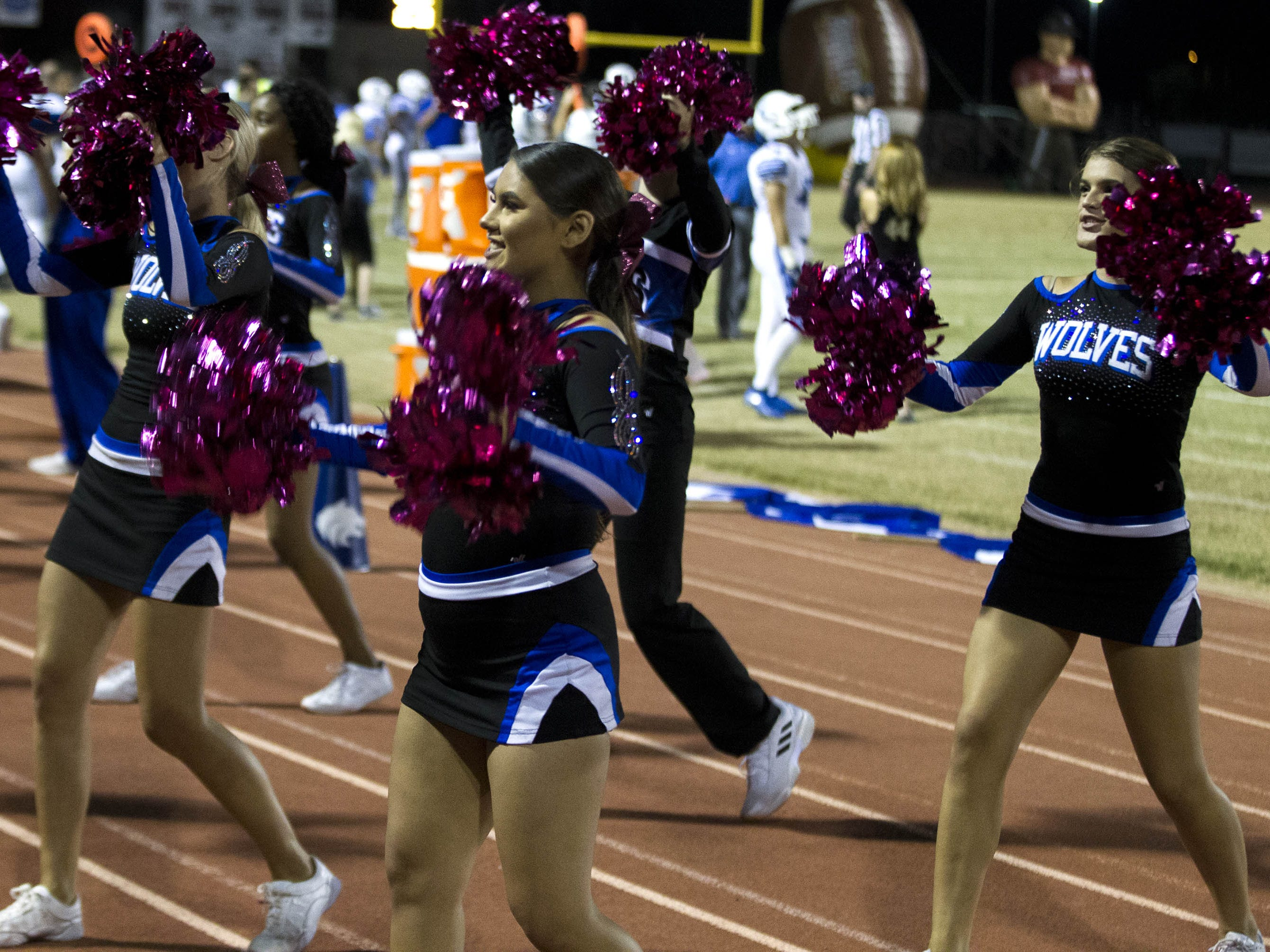 Chandler High School cheerleaders do their thing before their game against crosstown rivals the Hamilton Huskies in Chandler, Friday, Oct. 26, 2018. #azhsfb
