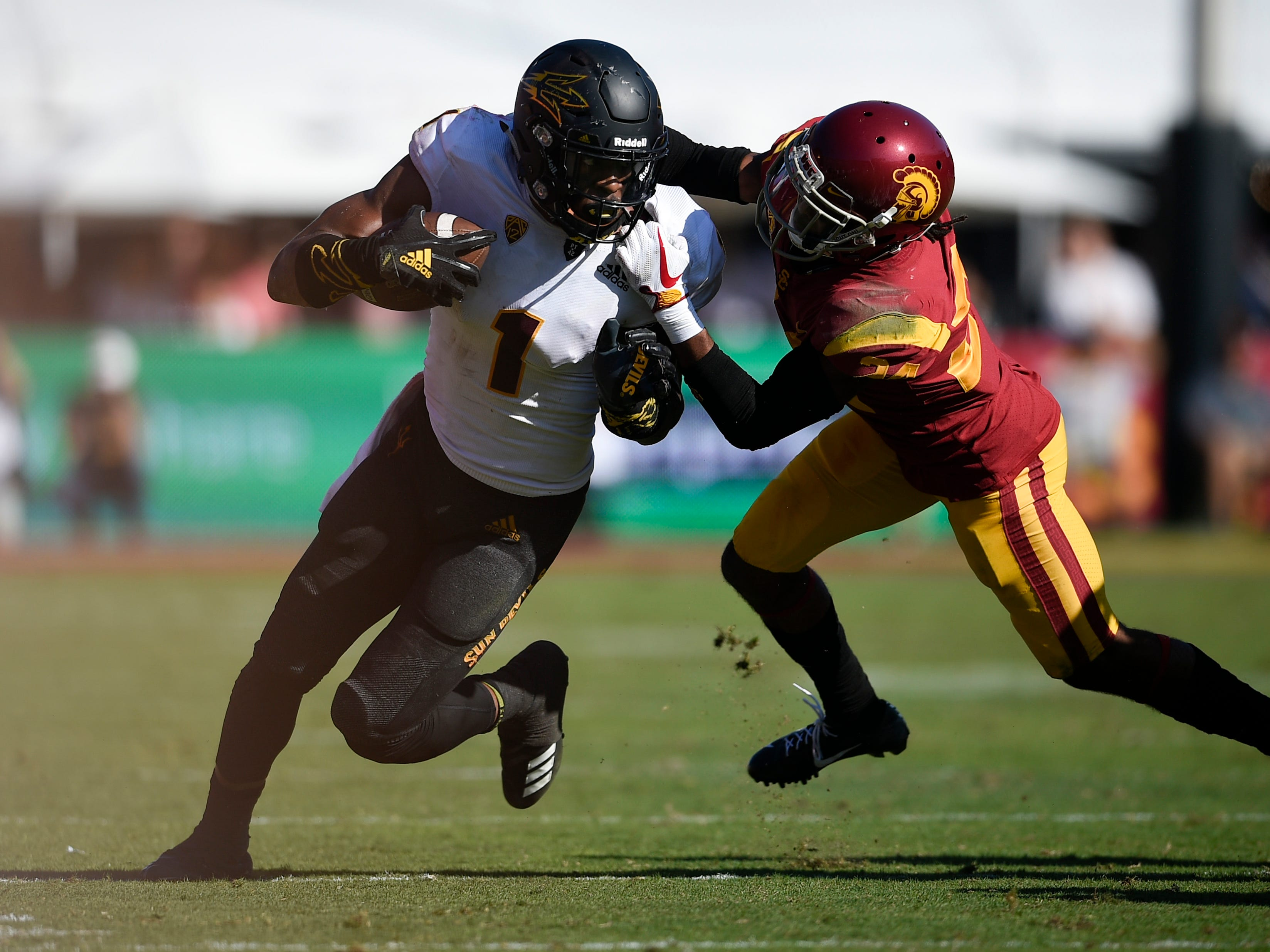 Oct 27, 2018; Los Angeles, CA, USA; Arizona State Sun Devils wide receiver N'Keal Harry (1) runs after a catch defended by Southern California Trojans linebacker Eli'jah Winston (34) during the second half at Los Angeles Memorial Coliseum. Mandatory Credit: Kelvin Kuo-USA TODAY Sports