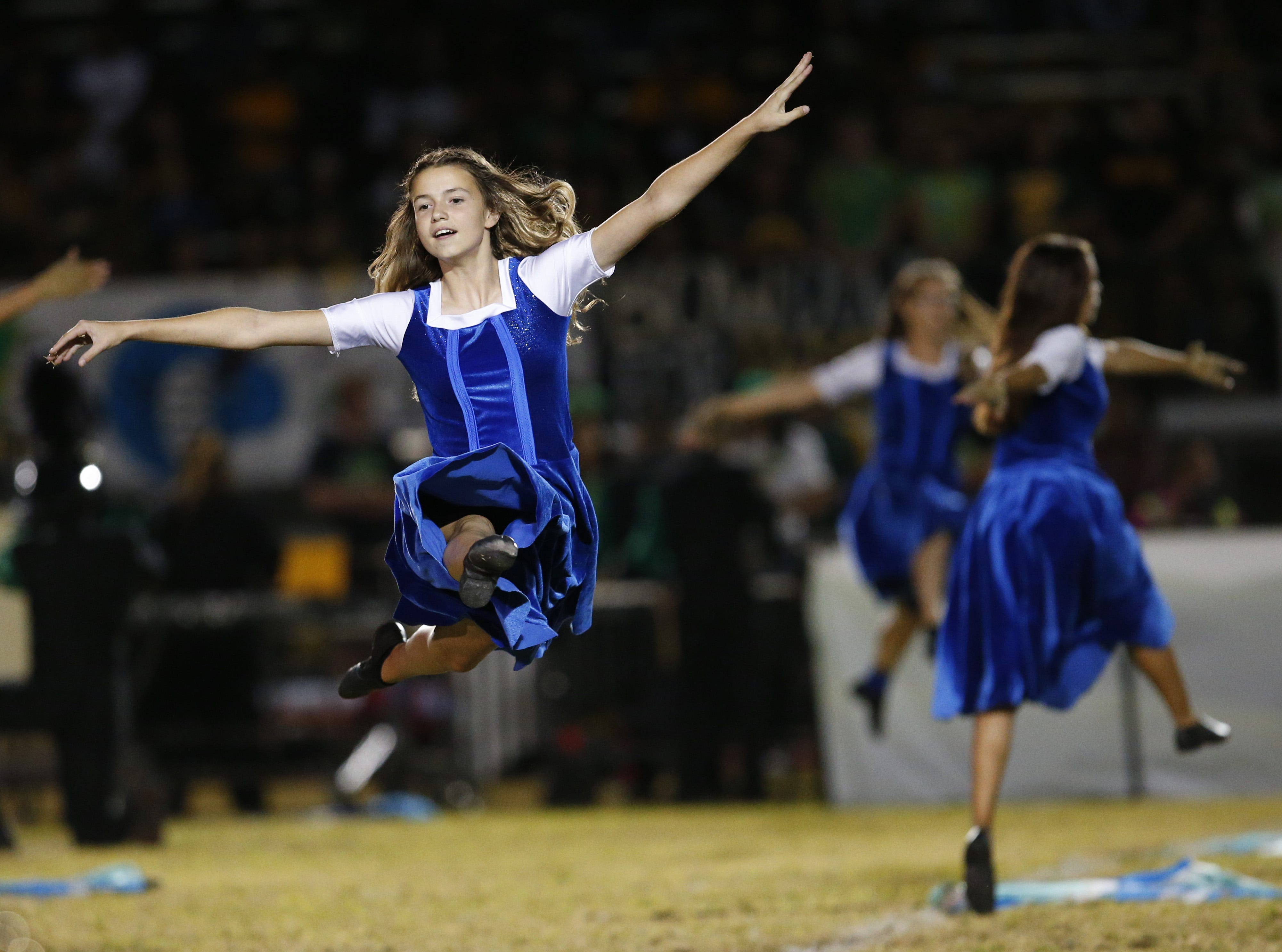 Peoria color guard, Phylicia Vance, performs during the half time show at a football game at Peoria High on October 26. #azhsfb