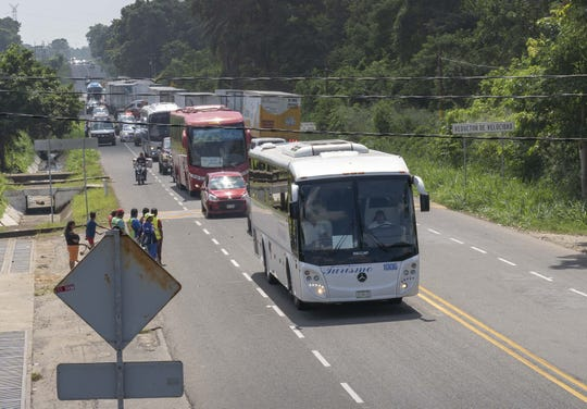 Several hundred Central American migrants walking on the road near Ciudad Hidalgo in southern Mexico after crossing the river from Guatemala were loaded onto buses and escorted by Mexican federal police and immigration officers. It's unclear if they were being taken to be deported or processed for asylum.