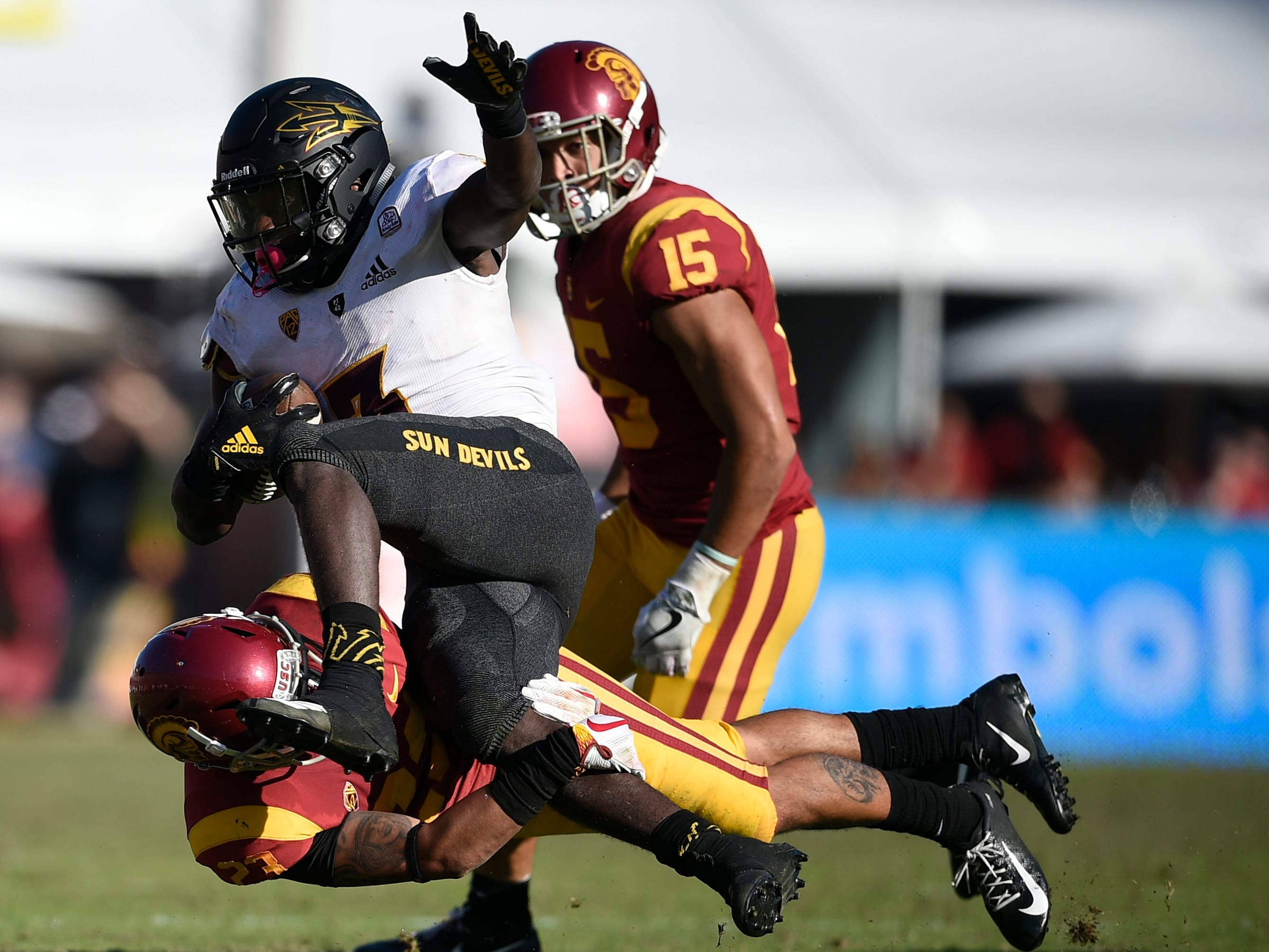 Oct 27, 2018; Los Angeles, CA, USA; Arizona State Sun Devils running back Eno Benjamin (3) runs the ball while Southern California Trojans corner back Jonathan Lockett (23) defends during the second half at Los Angeles Memorial Coliseum. Mandatory Credit: Kelvin Kuo-USA TODAY Sports