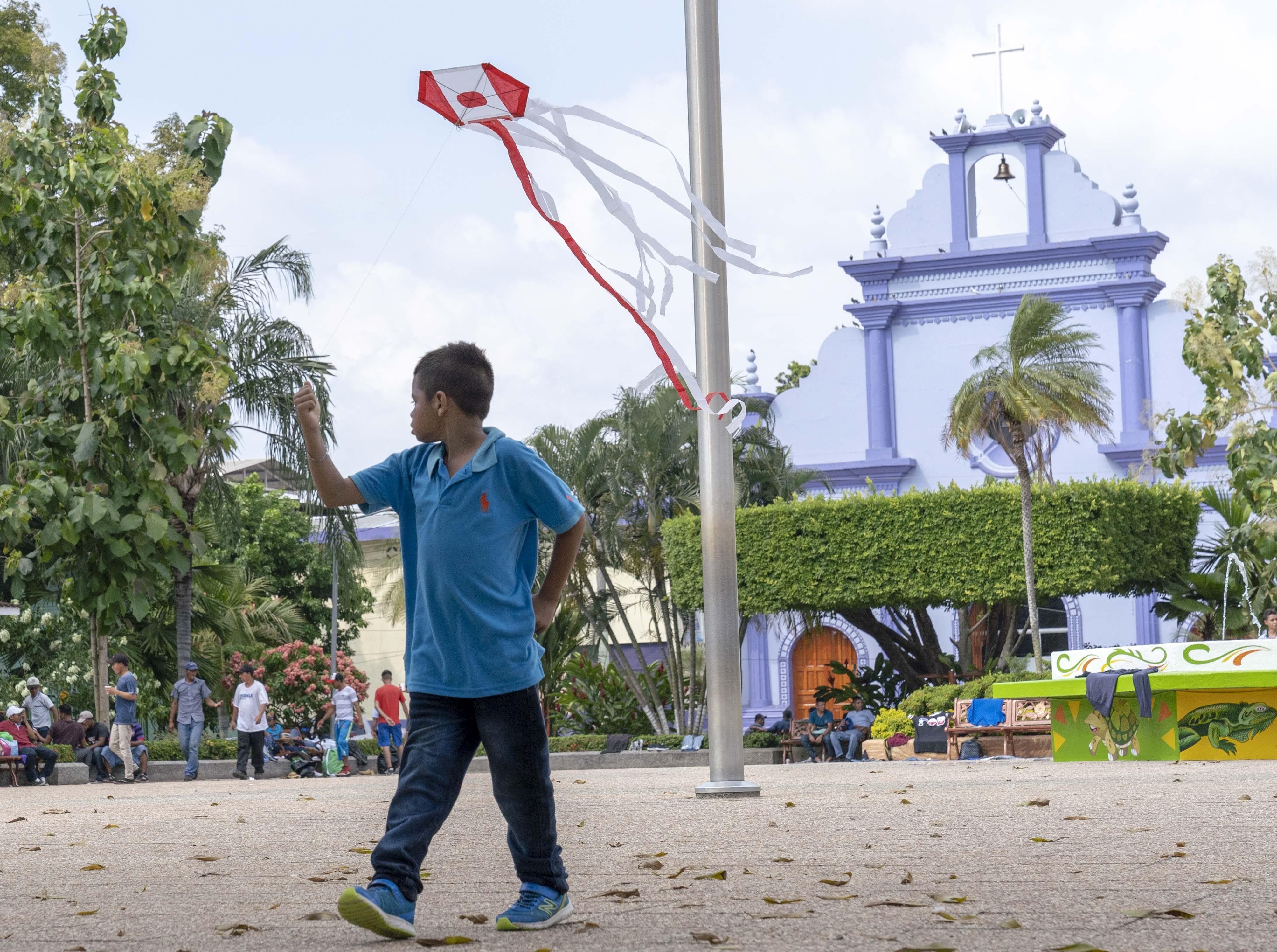 Migrant children from Honduras and El Salvador play in the park in Tecun Uman, Guatemala.