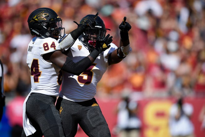 Oct 27, 2018; Los Angeles, CA, USA; Arizona State Sun Devils running back Eno Benjamin (3) celebrates after a touchdown with wide receiver Frank Darby (84) during the first half against the Southern California Trojans at Los Angeles Memorial Coliseum. Mandatory Credit: Kelvin Kuo-USA TODAY Sports
