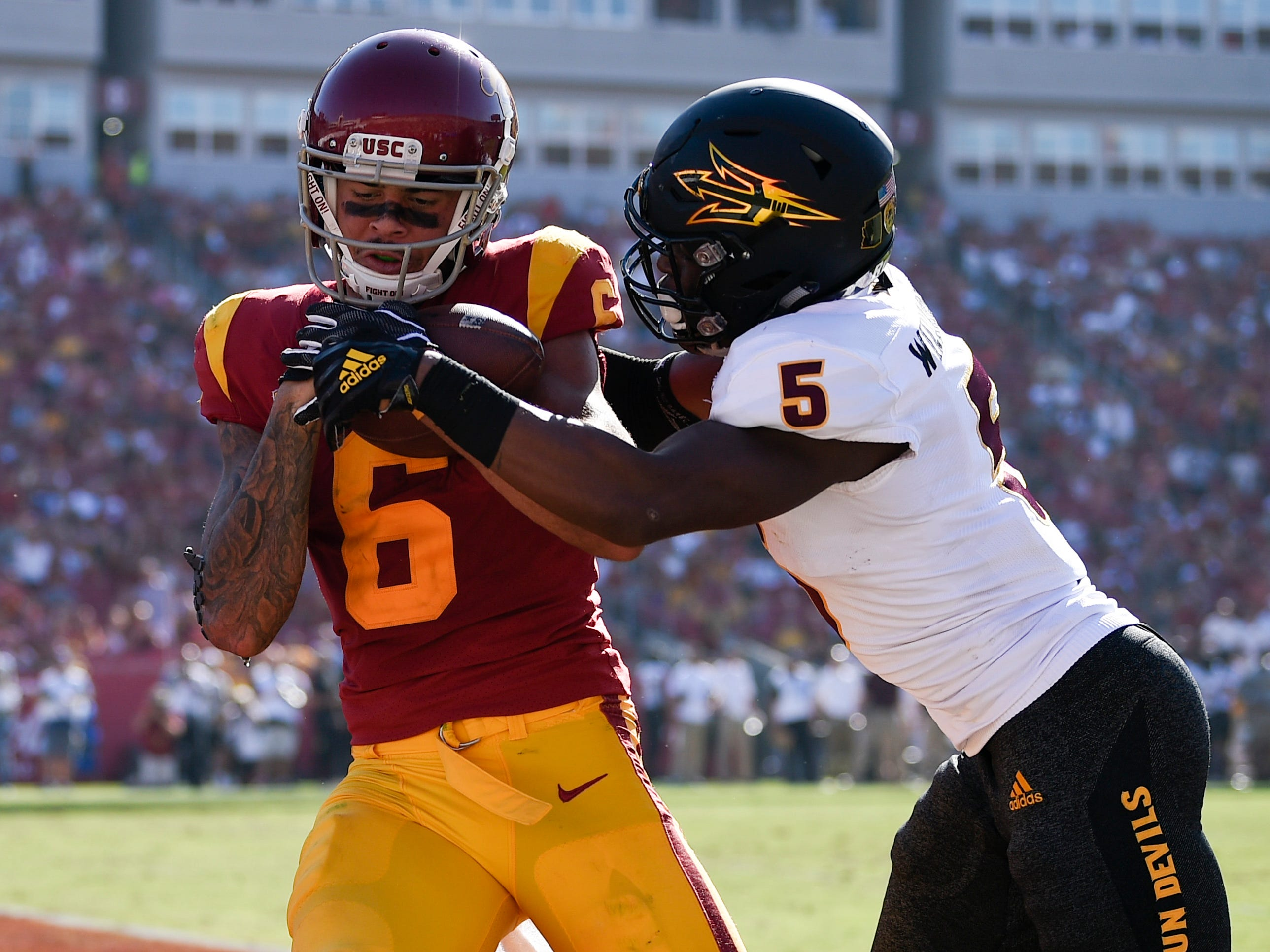 Oct 27, 2018; Los Angeles, CA, USA; Southern California Trojans wide receiver Michael Pittman Jr. (6) catches a touchdown pass while Arizona State Sun Devils defensive back Kobe Williams (5) defends during the second half at Los Angeles Memorial Coliseum. Mandatory Credit: Kelvin Kuo-USA TODAY Sports