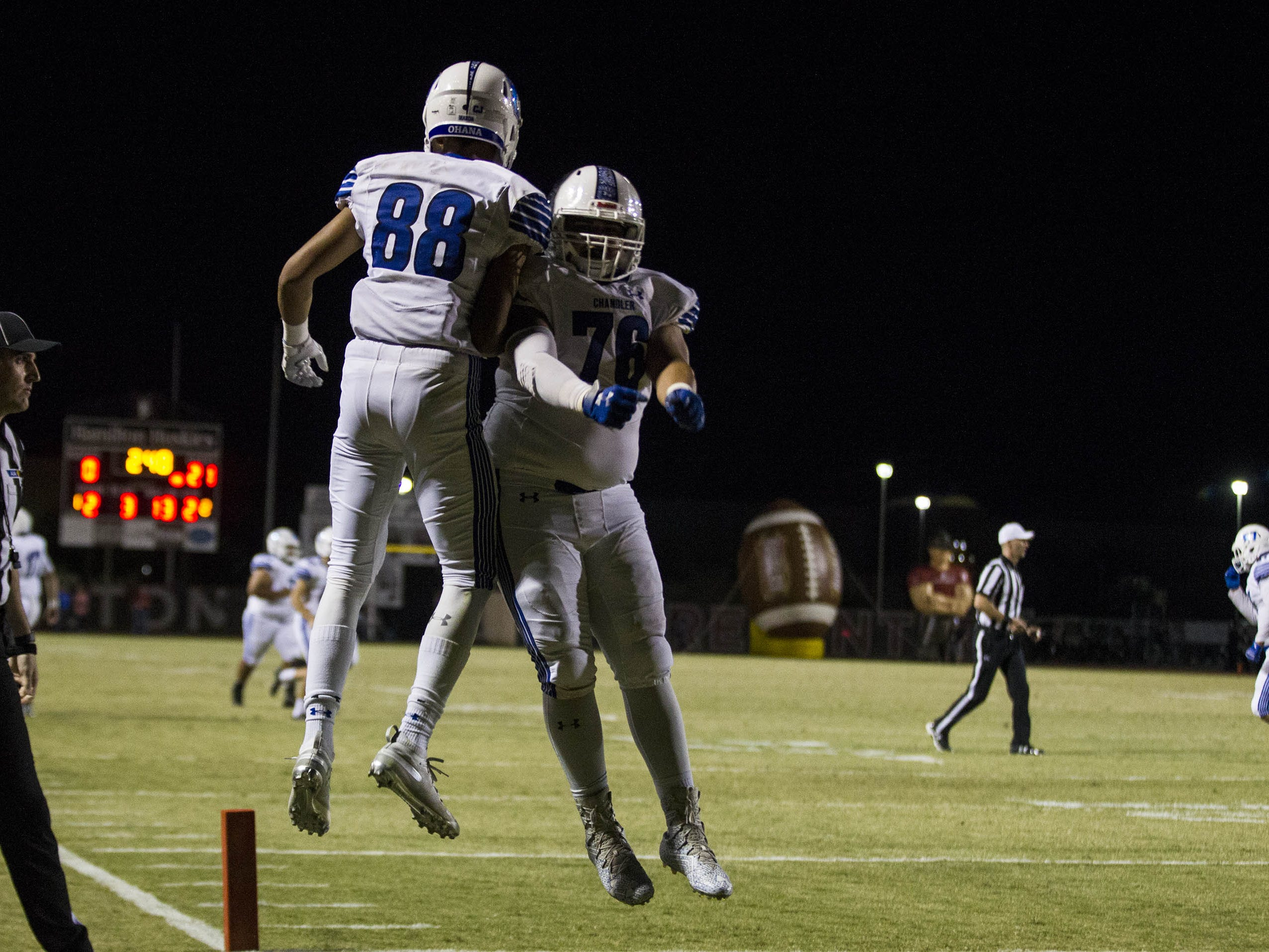 Chandler's Daseau Puffer celebrates his touchdown with his lineman Dylan Collier during their game with Hamilton in Chandler, Friday, Oct. 26, 2018. #azhsfb