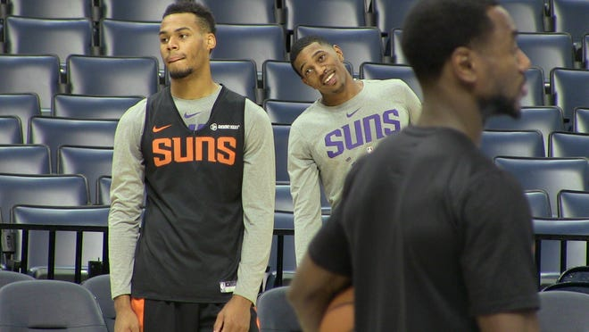 Rookie point guards Elie Okobo (Black Suns jersey) and De'Anthony Melton looking to get up shots at Saturday's shootaround before Phoenix played against the Memphis Grizzlies.