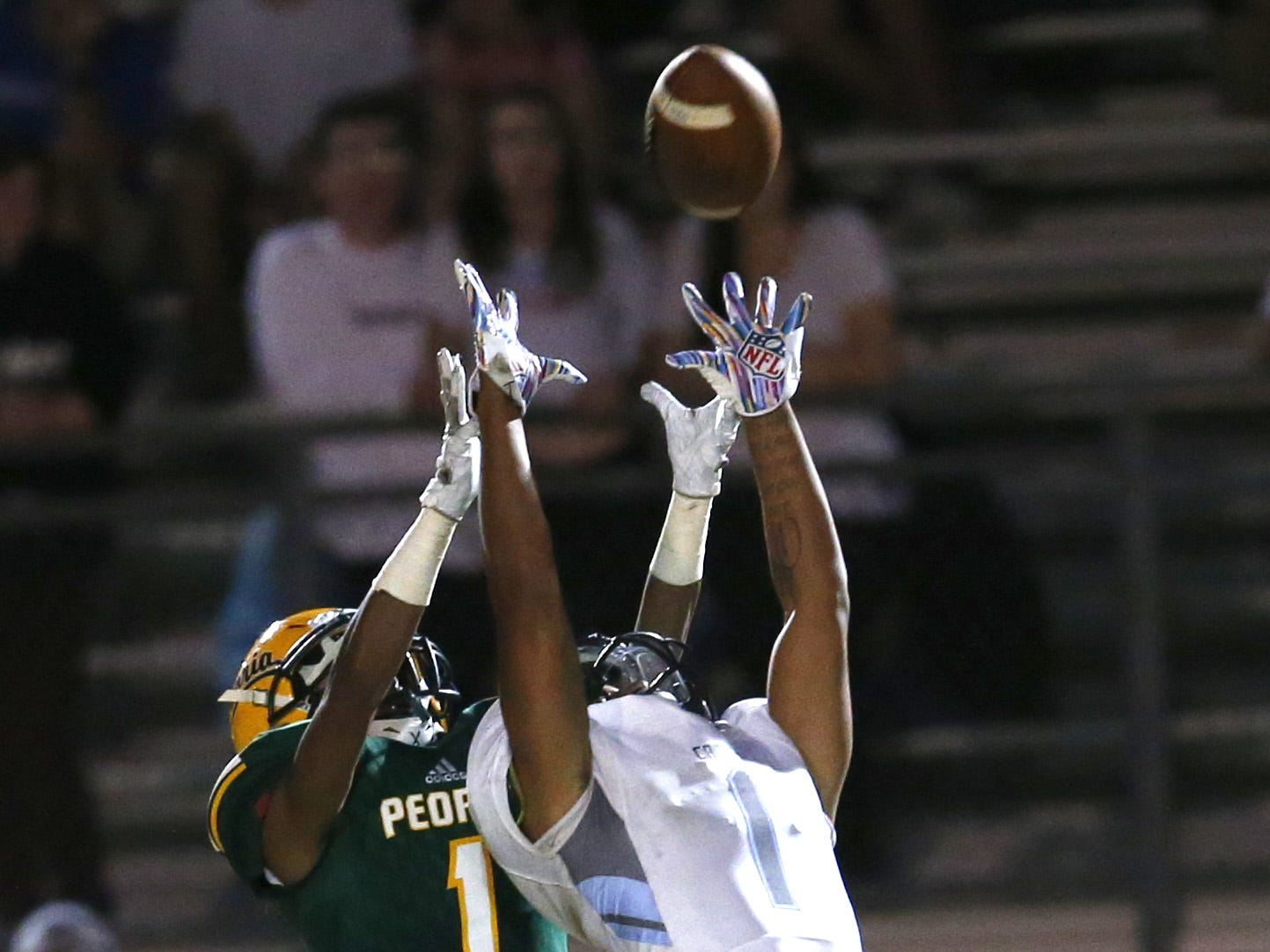 Cactus' Rylee Williams (1) breaks up a pass intended for Peoria's Jovon Scott (1) during a football game at Peoria High on October 26. #azhsfb