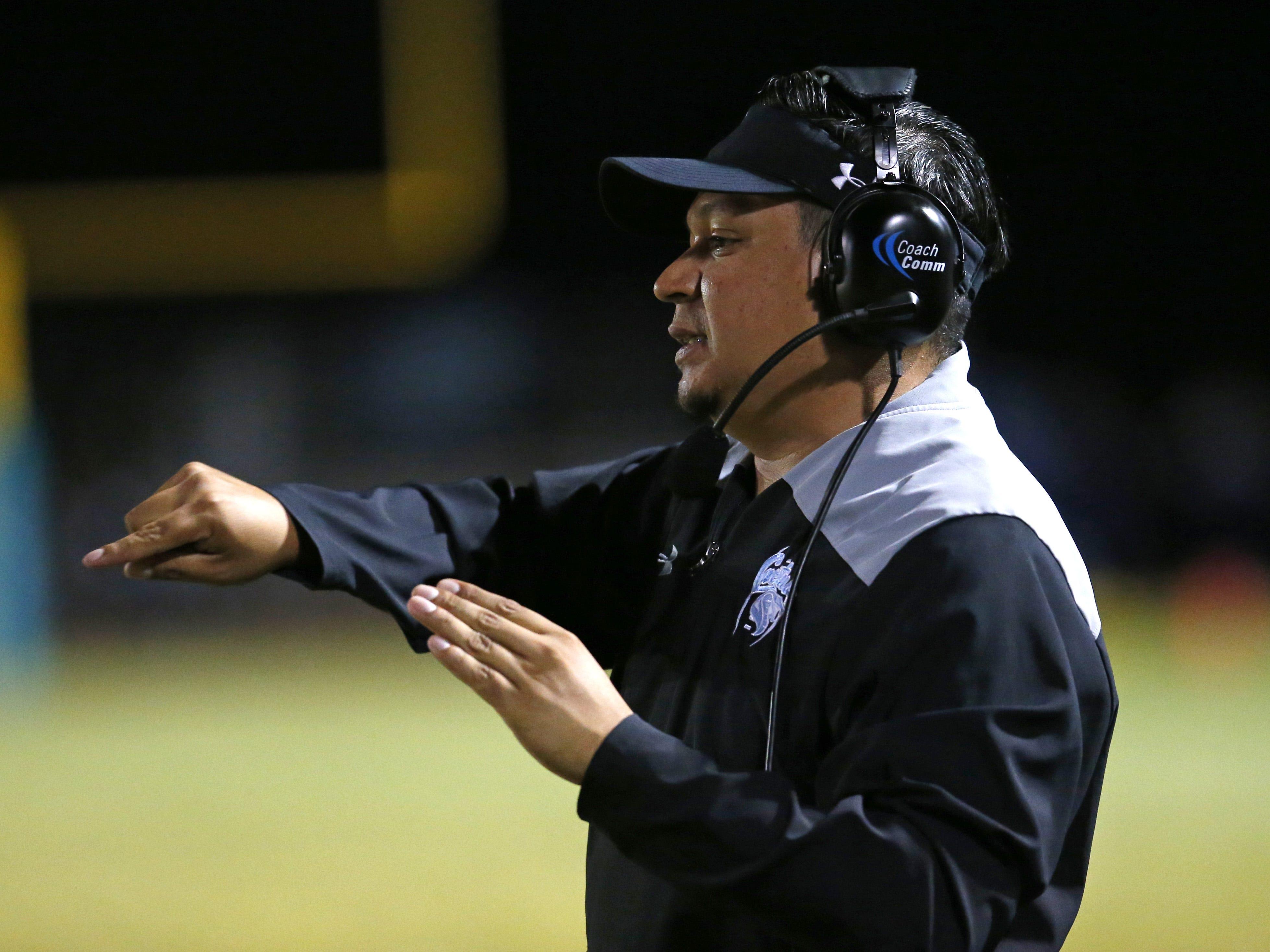 Cactus head coach Joseph Ortiz signals to his team during a football game against the Peoria at Peoria High on October 26. #azhsfb