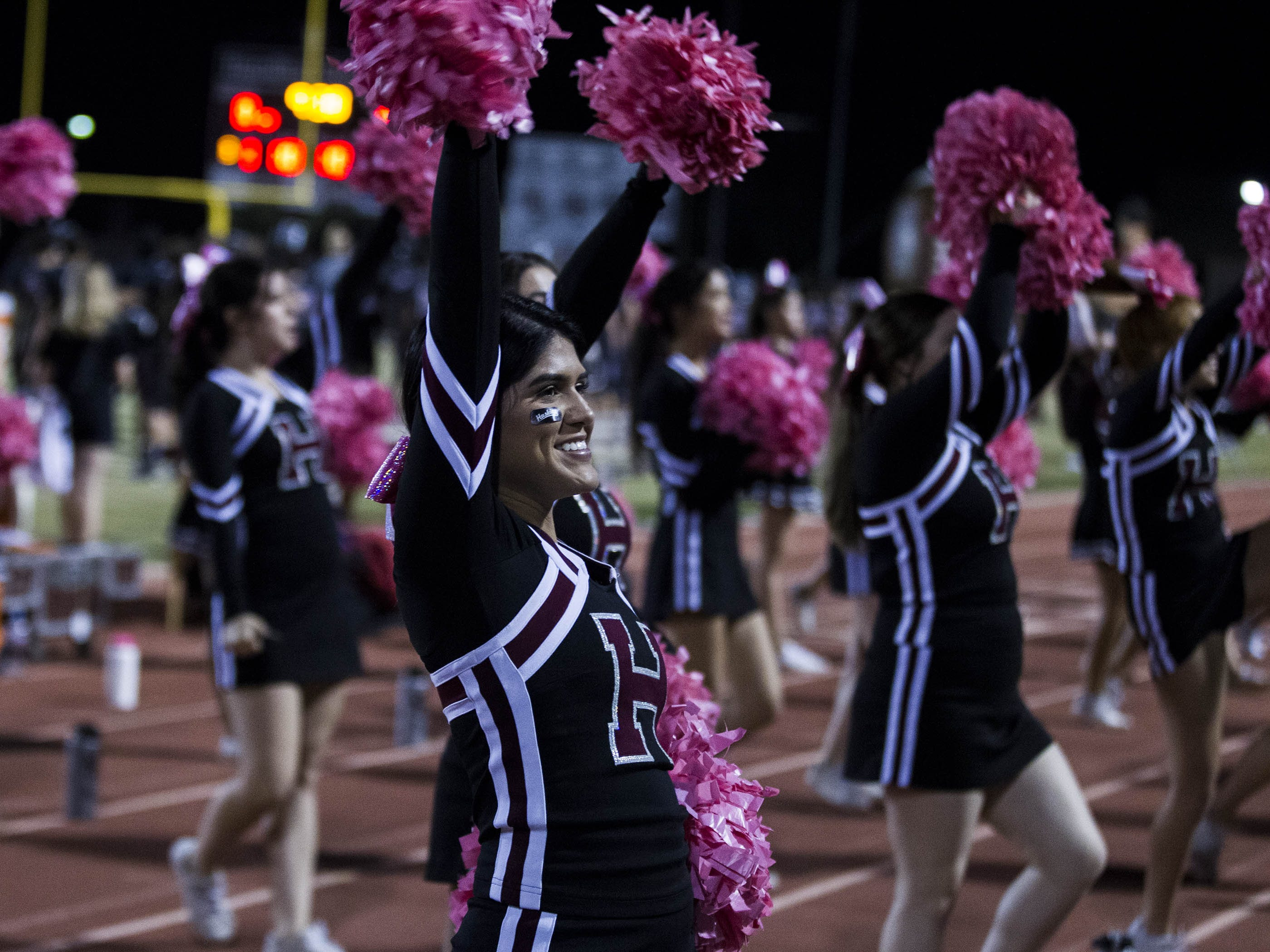 Hamilton High School cheerleaders do their thing during their game against crosstown rivals the Chandler Wolves in Chandler, Friday, Oct. 26, 2018. #azhsfb
