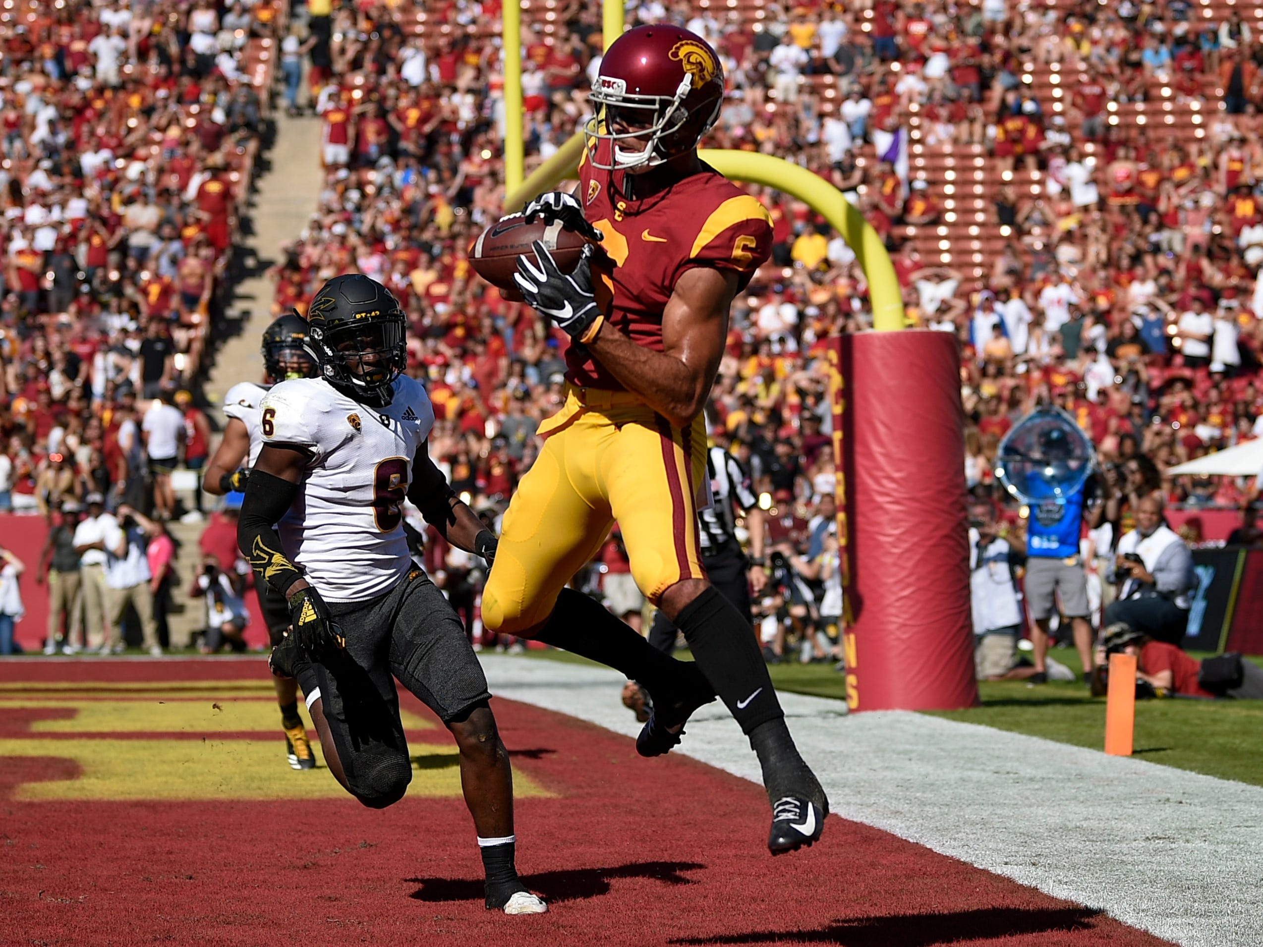 Oct 27, 2018; Los Angeles, CA, USA; Southern California Trojans wide receiver Michael Pittman Jr. (6) catches a pass for a touchdown while Arizona State Sun Devils defensive back Evan Fields (6) defends during the first half at Los Angeles Memorial Coliseum. Mandatory Credit: Kelvin Kuo-USA TODAY Sports