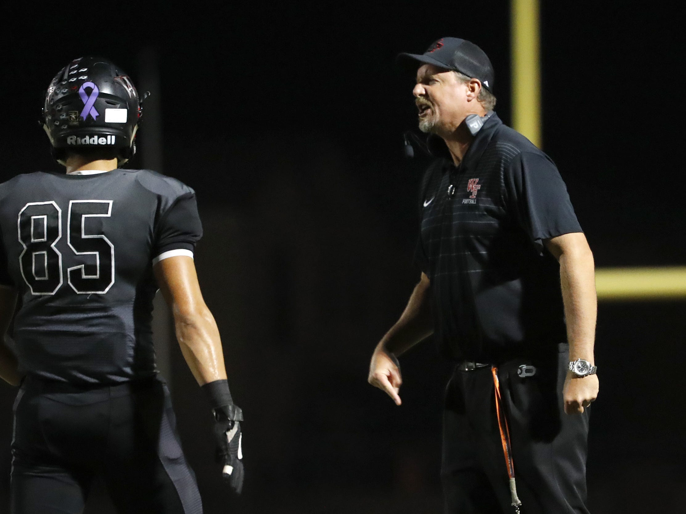 Williams Field's head coach Steve Campbell talks to his team during a timeout in the first half against Higley at Williams Field High School in Gilbert, Ariz. on October 26, 2018.