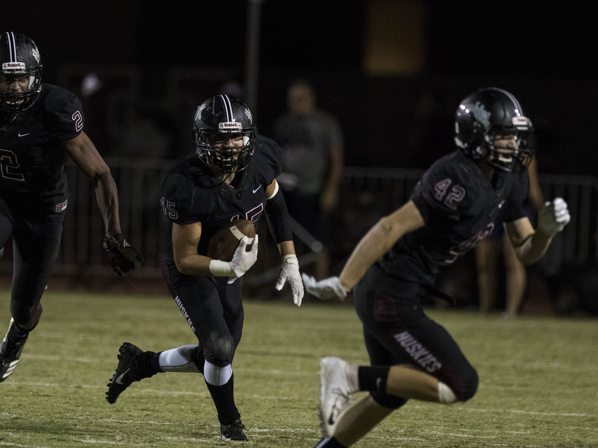 Hamilton's Nathaniel Zimmerman looks for blockers after making an interception against Chandler during their game in Chandler, Friday, Oct. 26, 2018. #azhsfb