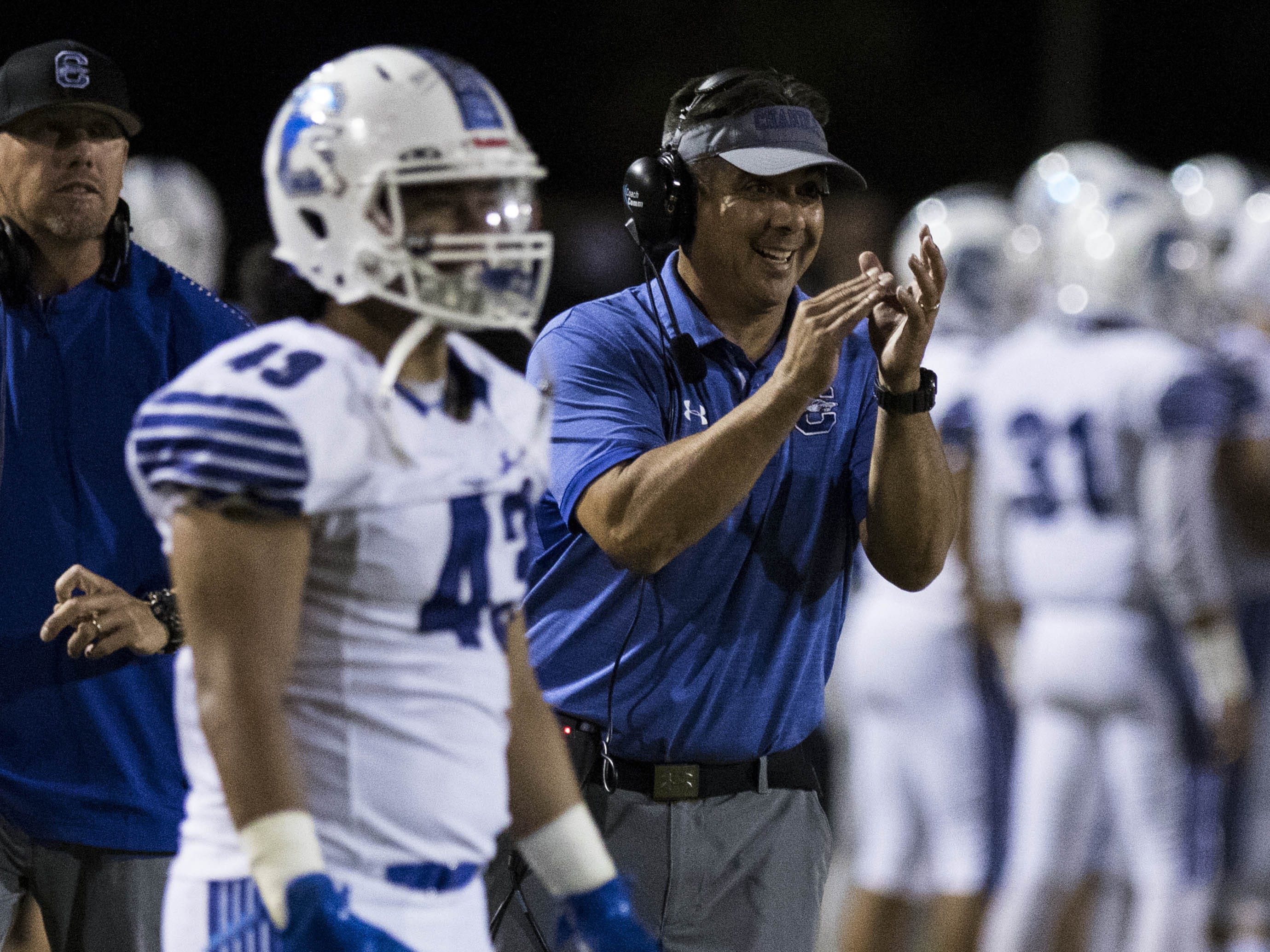 Chandler head coach Shaun AguanoÊclaps as his team goes up 21-0 against Hamilton's during their game in Chandler, Friday, Oct. 26, 2018. #azhsfb