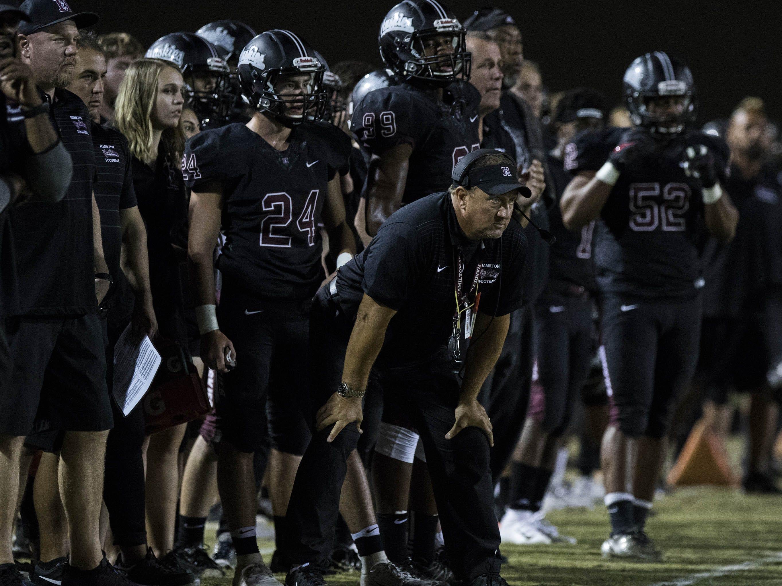 Hamilton Huskies' head coach Mike Zdebski watches his team agains the crosstown rivals the Chandler Wolves during their game in Chandler, Friday, Oct. 26, 2018. #azhsfb