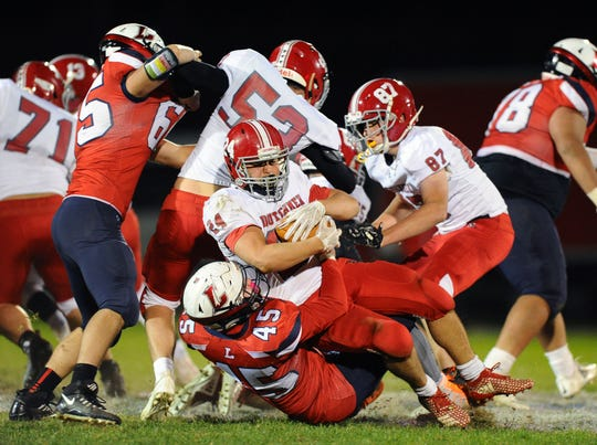 A-C's Caleb Turner (24) is stopped by Lebanon's Andrew Bowers (45).
