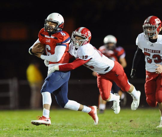 Lebanon's Leighton Rivera (6) runs for a first down after catching this first quarter pass.Defending on the play is A-C's Daniel Tobias.