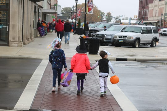 Trick or treat is still set for Thursday in many local communities but some may reschedule due to a 90 percent chance of rain in the area on Halloween.