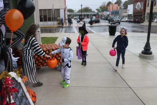 The rain was not going to stop Port Clinton kids from getting candy during the annual Downtown Trick-or-Treat on Saturday.