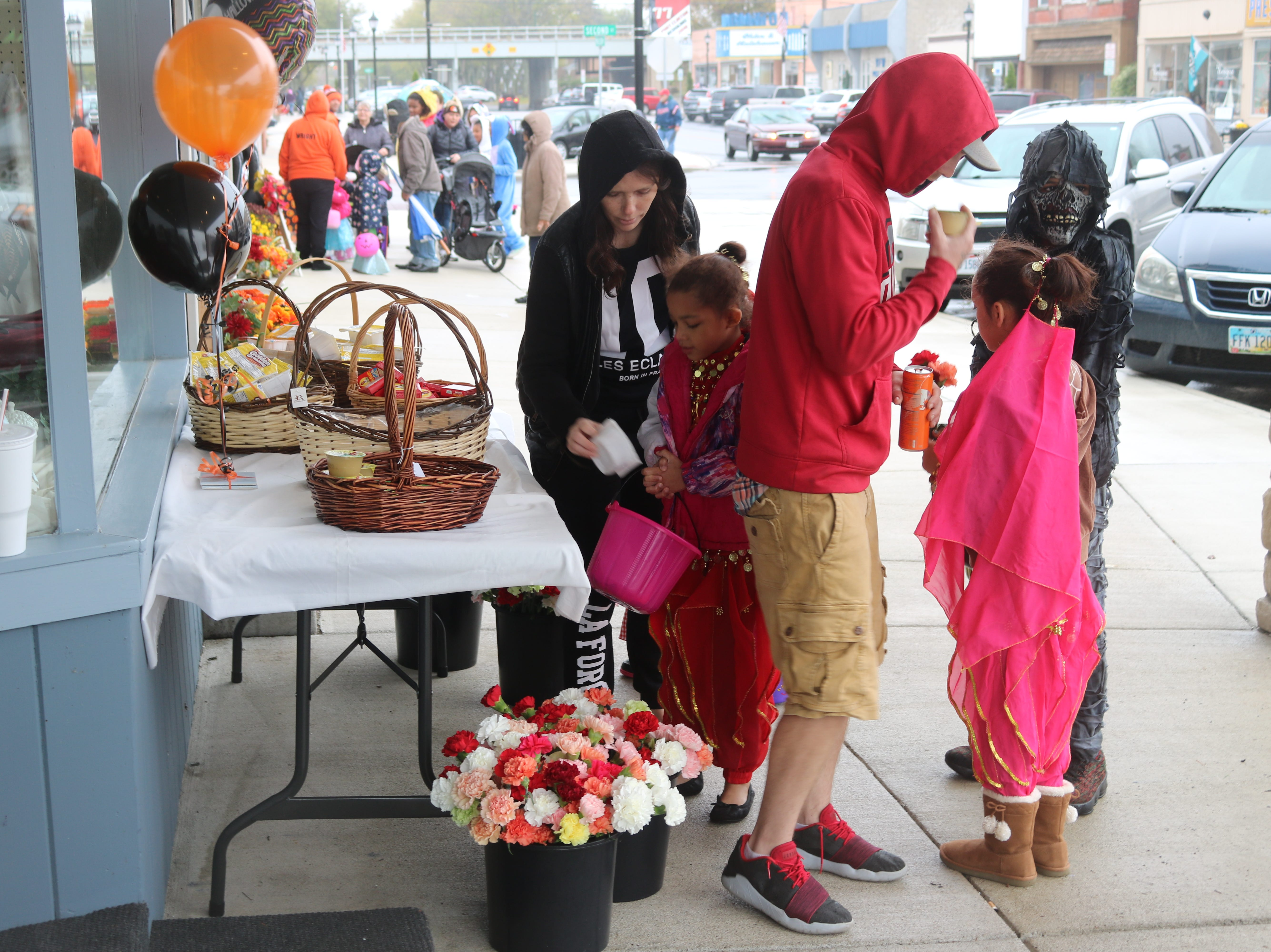 Despite the wet and chilly weather, children and families lined Second and Madison streets as Port Clinton hosted its seventh annual Downtown Trick-or-Treat.