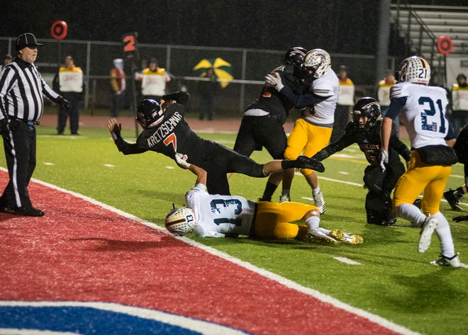 Marine City High School running back Jack Kretzschmar (7) falls into the end zone with the football in the first quarter of their Division 5 pre-district tournament game Saturday, Oct. 27, 2018 at East China Stadium. Kretzschmar's touchdown brought Marine City up 20-0.