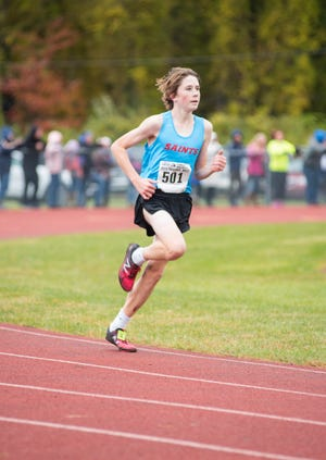 St. Clair High School sophomore Jack Pennewell nears the finish line in the division 2 class A regional cross country race Saturday, Oct. 27, 2018 at Algonac High School.