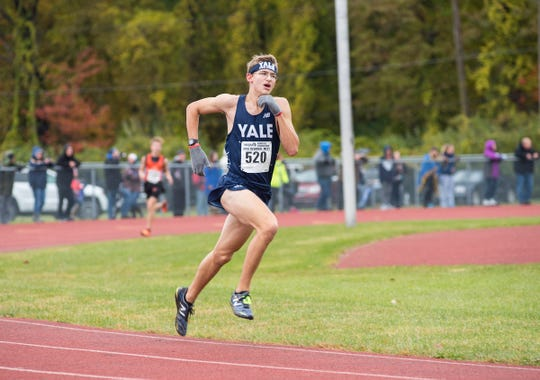 Yale High School junior Hunter Richards nears the finish line in the division 2 class A regional cross country race Saturday, Oct. 27, 2018 at Algonac High School.