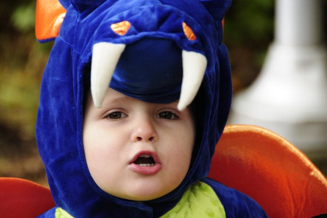 LIttle dragon Tanner Bauer, 2, of Fort Gratiot roars during the Halloween Stroll on Saturday, Oct. 27, 2018 at Sanborn Park in Port Huron.