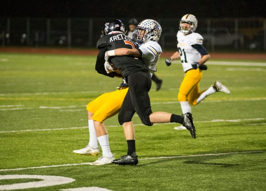 Marine City High School running back Jack Kretzschmar (7) is brought down by Clawson's Tristen Perry in the first quarter of their D5 pre-district tournament game Saturday, Oct. 27, 2018 at East China Stadium.