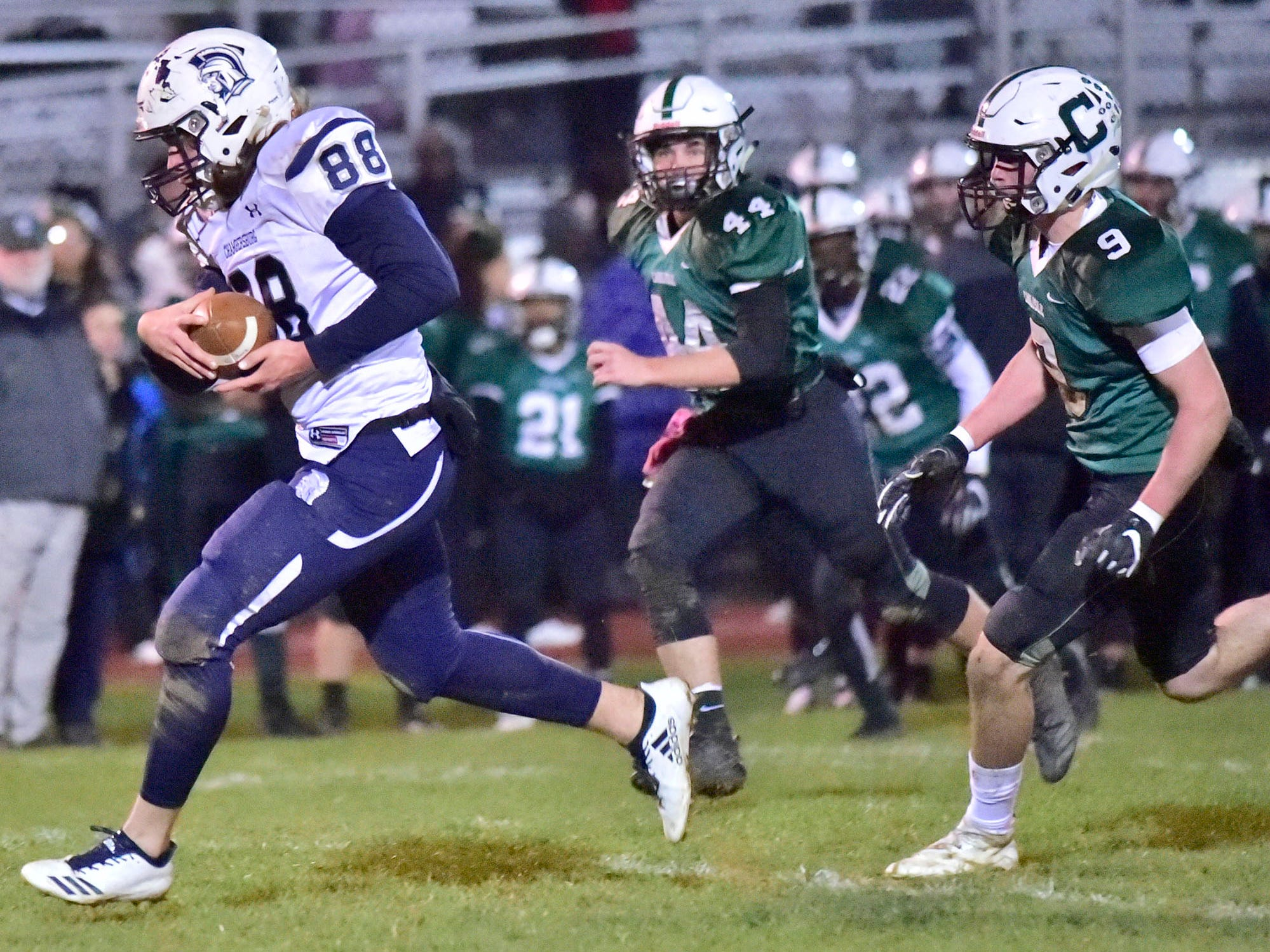 Chambersburg's Garner Funk (88) takes off for a long run after completing a pass during the 26-20 victory over Carlisle on Friday, October 26, 2018.