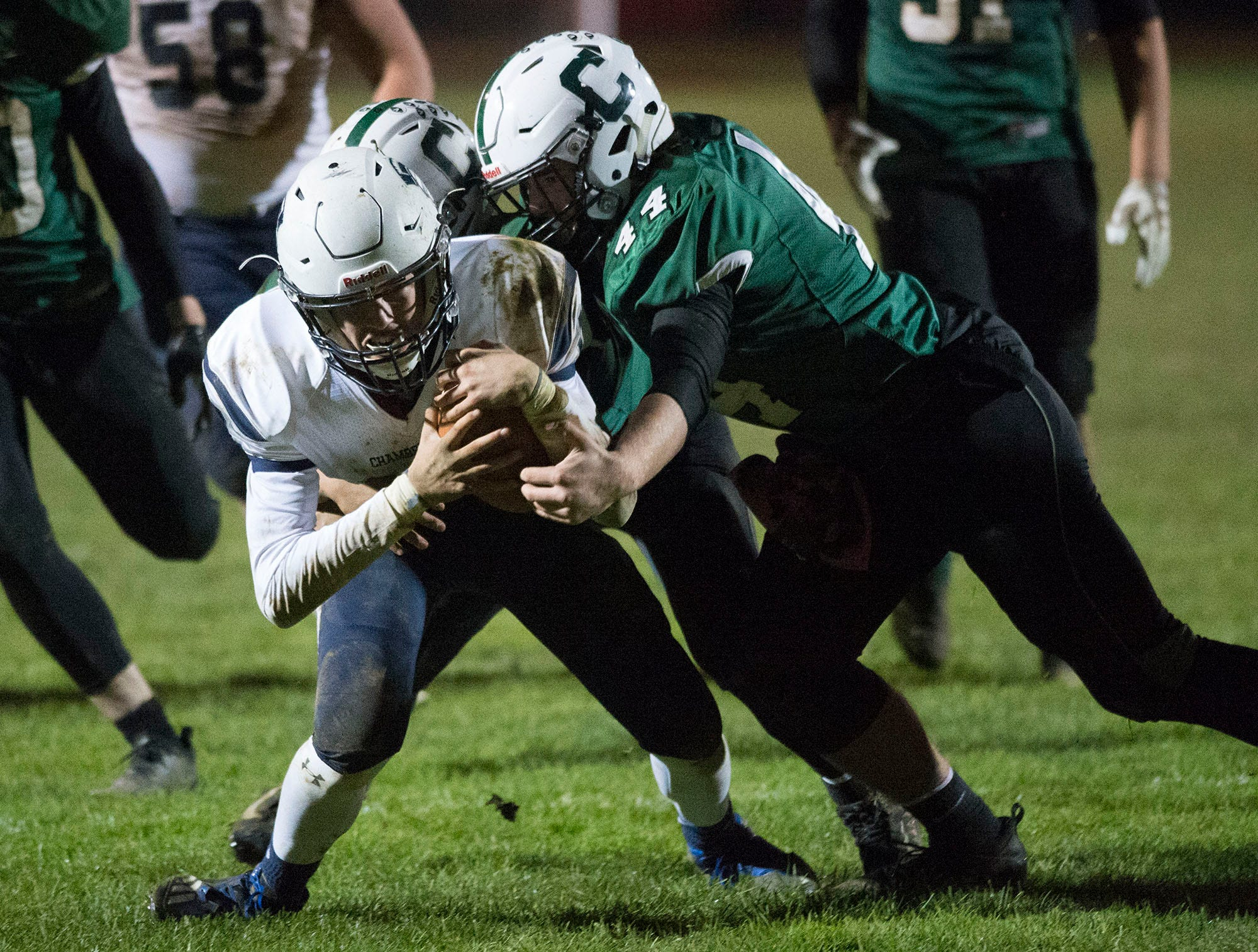 Chambersburg QB Brady Stumbaugh muscles to the one yard line before scoring for the Trojans as Carlisle's Braydon Keller (44) delivers a hit. Chambersburg won 26-20 on a last second interception.