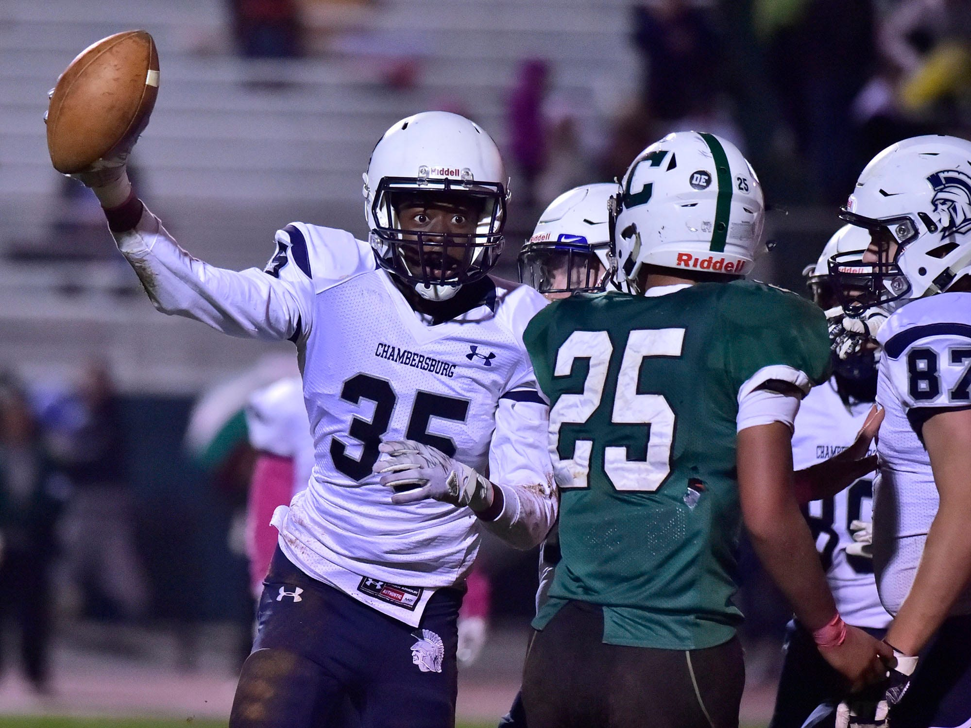 Chambersburg's DaQuon Rogers (35) celebrates a Trojan interception during the Carlisle game on Friday, October 26, 2018.