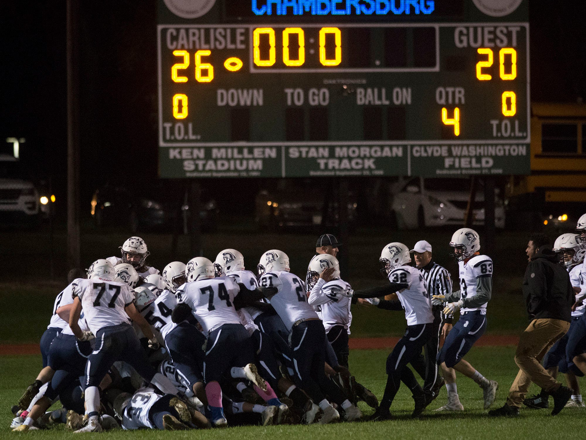 Chambersburg celebrates a spectacular finish to their regular season during a 26-20 Trojan victory on Friday, October 26, 2018..