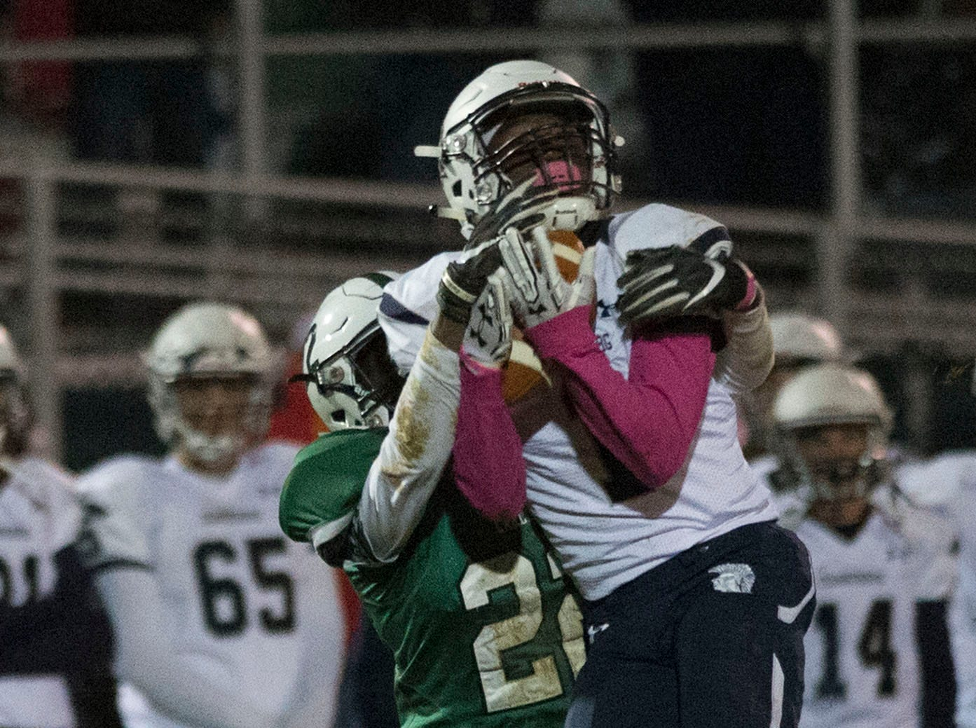 Kevin Lee Jr. (1) of Chambersburg makes one of several critical catches over Carlisle's Jamari Brown (22) late in the game during the 26-20 victory over on Friday, October 26, 2018.