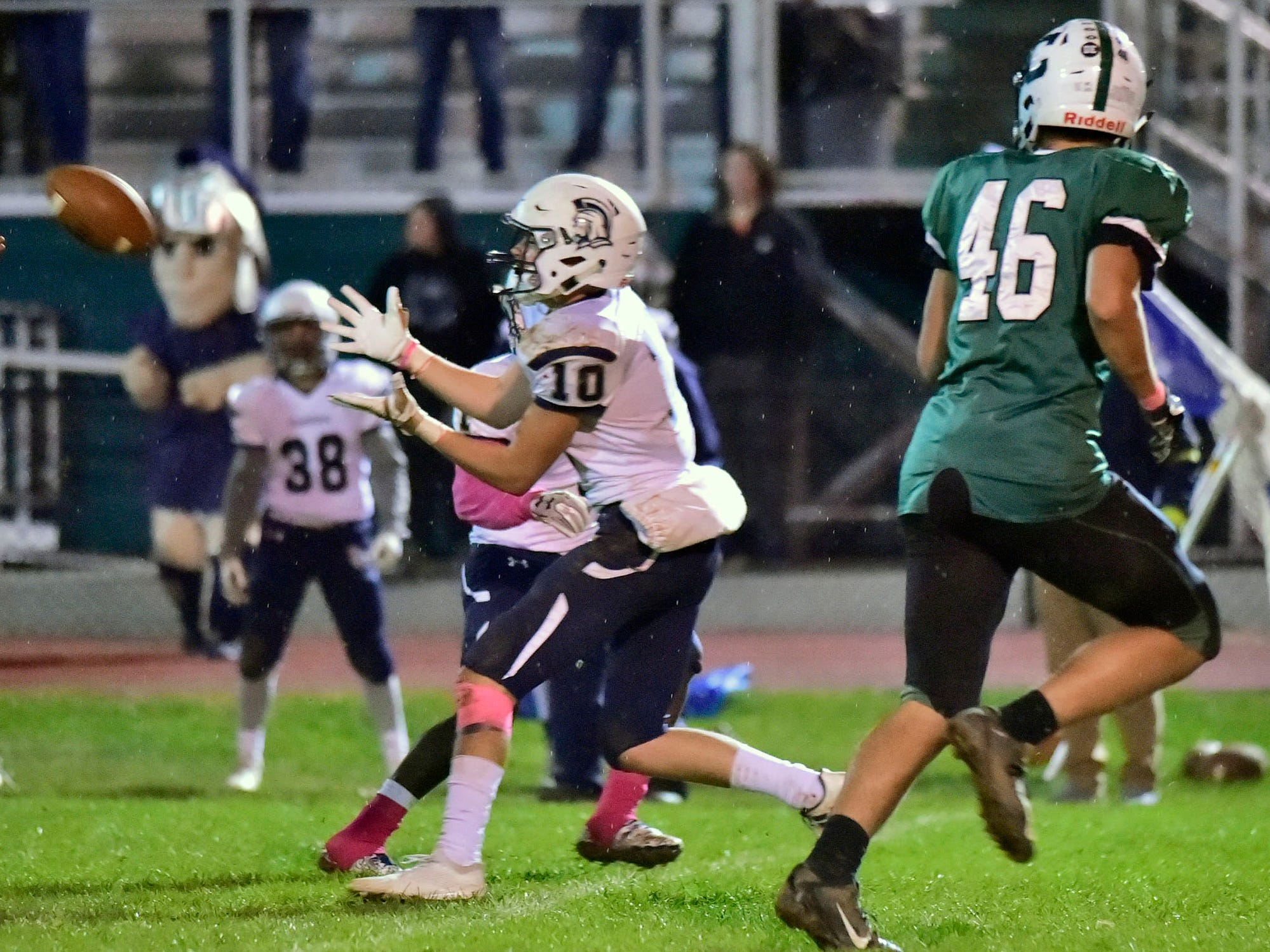 Chambersburg's Brady Hughes (10) is set to pick off a pass with seconds remaining in the game to seal the vactory during the 26-20 victory over Carlisle on Friday, October 26, 2018.