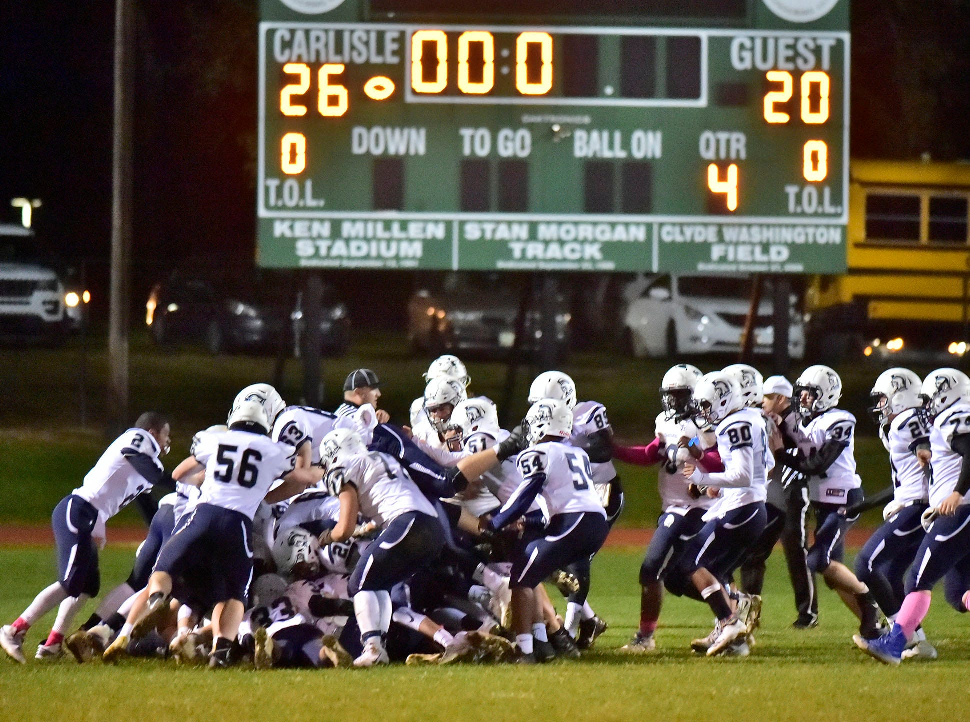 Chambersburg celebrates a spectacular finish to their regular season during a 26-20 Trojan victory over Carlisle on Friday, October 26, 2018.