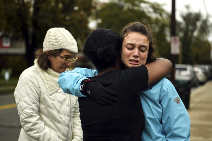 From left, Kate Rothstein looks on as Tammy Hepps hugs Simone Rothstein, 16, on the intersection of Shady Avenue and Northumberland Street after multiple people were shot at The Tree of Life Congregation synagogue, Oct, 27, 2018, in Squirrel Hill. Simone, of Squirrel Hill, is the daughter of Kate. (Alexandra Wimley/Pittsburgh Post-Gazette via AP)/Pittsburgh Post-Gazette via AP)