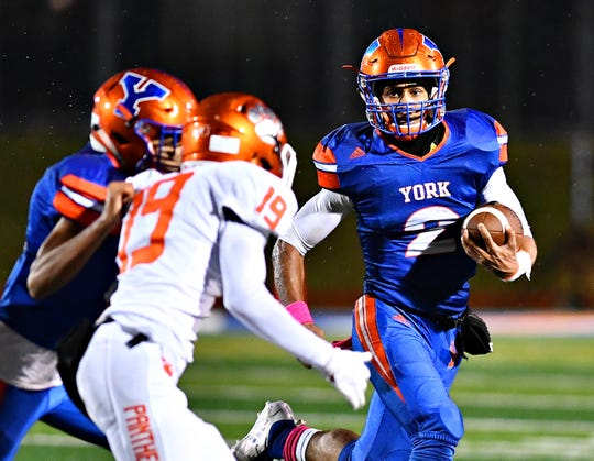 Tobee Stokes runs the ball last season for York High. Stokes is expected to be the Bearcats' starting quarterback this season.