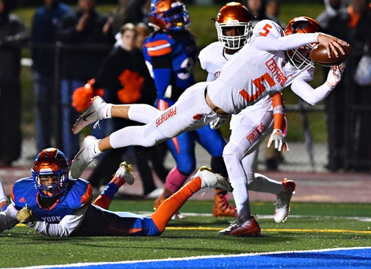 Central York's Beau Pribula scores a touchdown during football action against York High at Smalls Field in York City, Friday, Oct. 26, 2018. York High would win the game 54-14, sharing the Division 1 title with Red Lion. Dawn J. Sagert photo