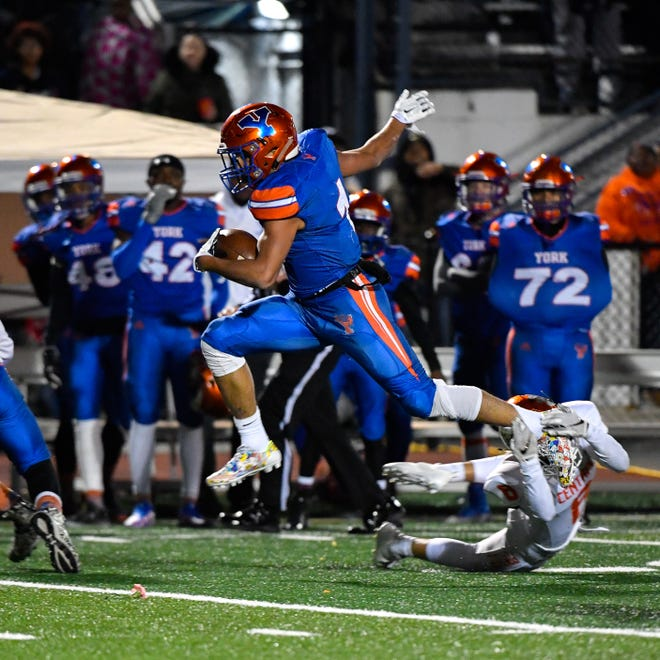 Dayjure Stewart (1) leaps over the defense during the YAIAA Division I title game at Smalls Athletic Field, Friday, October 26, 2018. The York High Bearcats defeated the Central York Panthers 54-14.